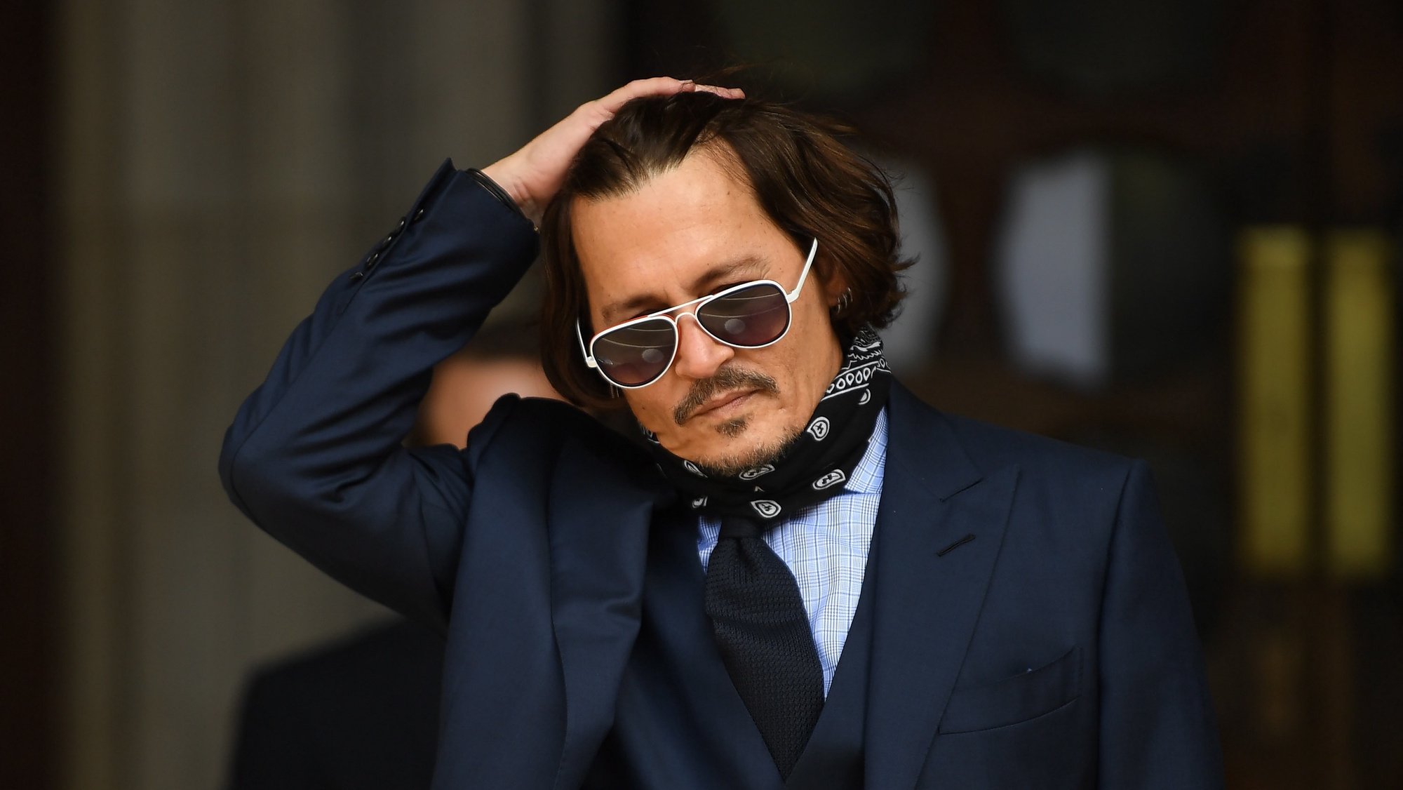 epa08792649 (FILE) - US actor Johnny Depp arrives at the Royal Courts of Justice in London, Britain, 14 July 2020 (reissued 02 November 2020). The UK High Court ruled against Depp in his libel trial against The Sun's newspaper publisher News Group Newspapers (NGN) over claims he abused his ex-wife, US actress Amber Heard, media reports state on 02 November 2020.  EPA/NEIL HALL *** Local Caption *** 56213511