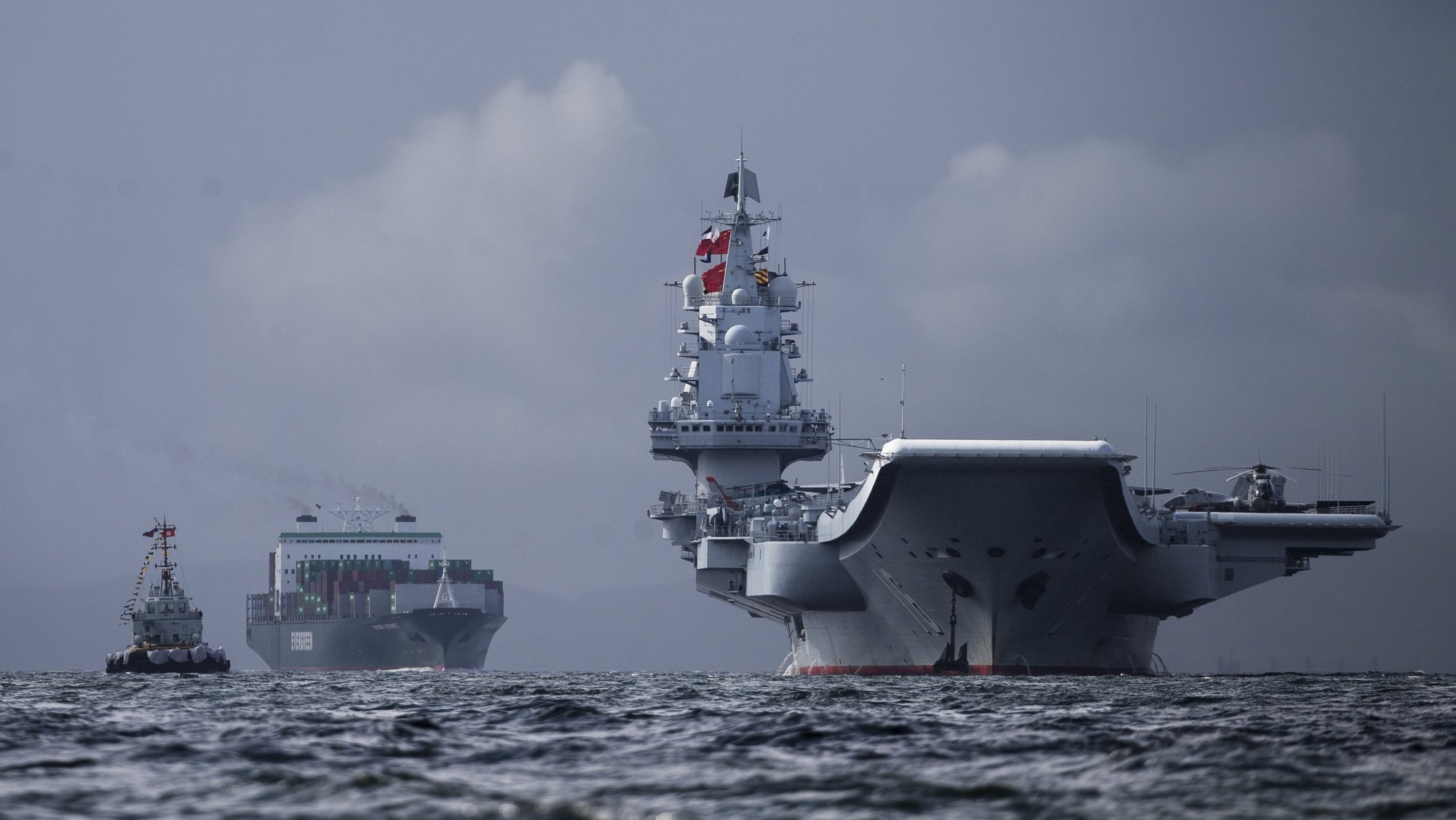 epaselect epa06071725 The Liaoning (R), the first aircraft carrier commissioned into China's military, arrives in Hong Kong, China, 07 July 2017. The Liaoning, a refitted former Soviet carrier that Beijing bought from a Ukraine shipyard in 1998, is making a 5-days port call to Hong Kong as part of the 20th anniversary celebrations of Hong Kong's return to Chinese sovereignty.  EPA/JEROME FAVRE