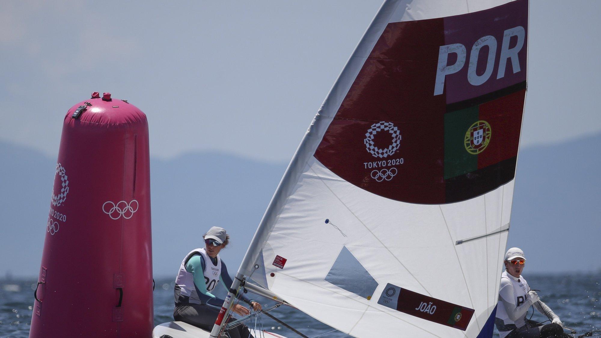 epa09361037 Laser Radial class sailor Velejadora Carolina Joao of Portugal during a training session for the Tokyo 2020 Olympic Games in Enoshima, Japan, 24 July 2021.  EPA/OLIVIER HOSLET