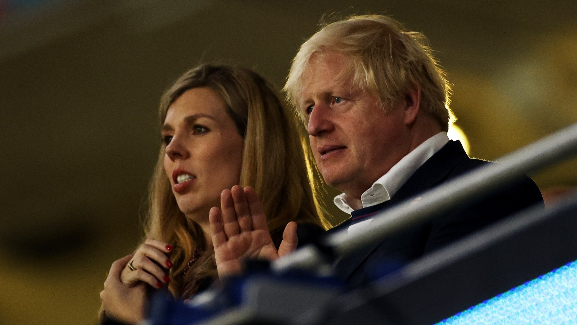 epa09339274 British Prime Minister Boris Johnson and his wife Carrie Johnson after the UEFA EURO 2020 final between Italy and England in London, Britain, 11 July 2021.  EPA/John Sibley / POOL (RESTRICTIONS: For editorial news reporting purposes only. Images must appear as still images and must not emulate match action video footage. Photographs published in online publications shall have an interval of at least 20 seconds between the posting.)