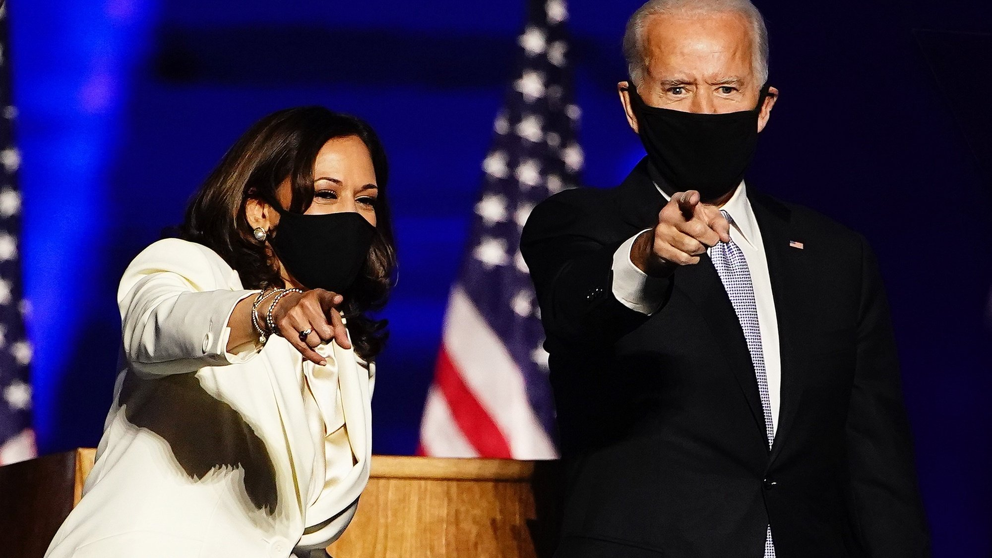epa08876558 (FILE) - Vice President-Elect Kamala Harris (L) and President-elect Joe Biden (R) gesture as they arrive for their victory address after being declared the winners in the 2020 US presidential election, in Wilmington, Delaware, USA, 07 November 2020 (reissued 11 December 2020). Time magazine has named Joe Biden and Kamala Harris 2020's Person of the Year.  EPA/JIM LO SCALZO
