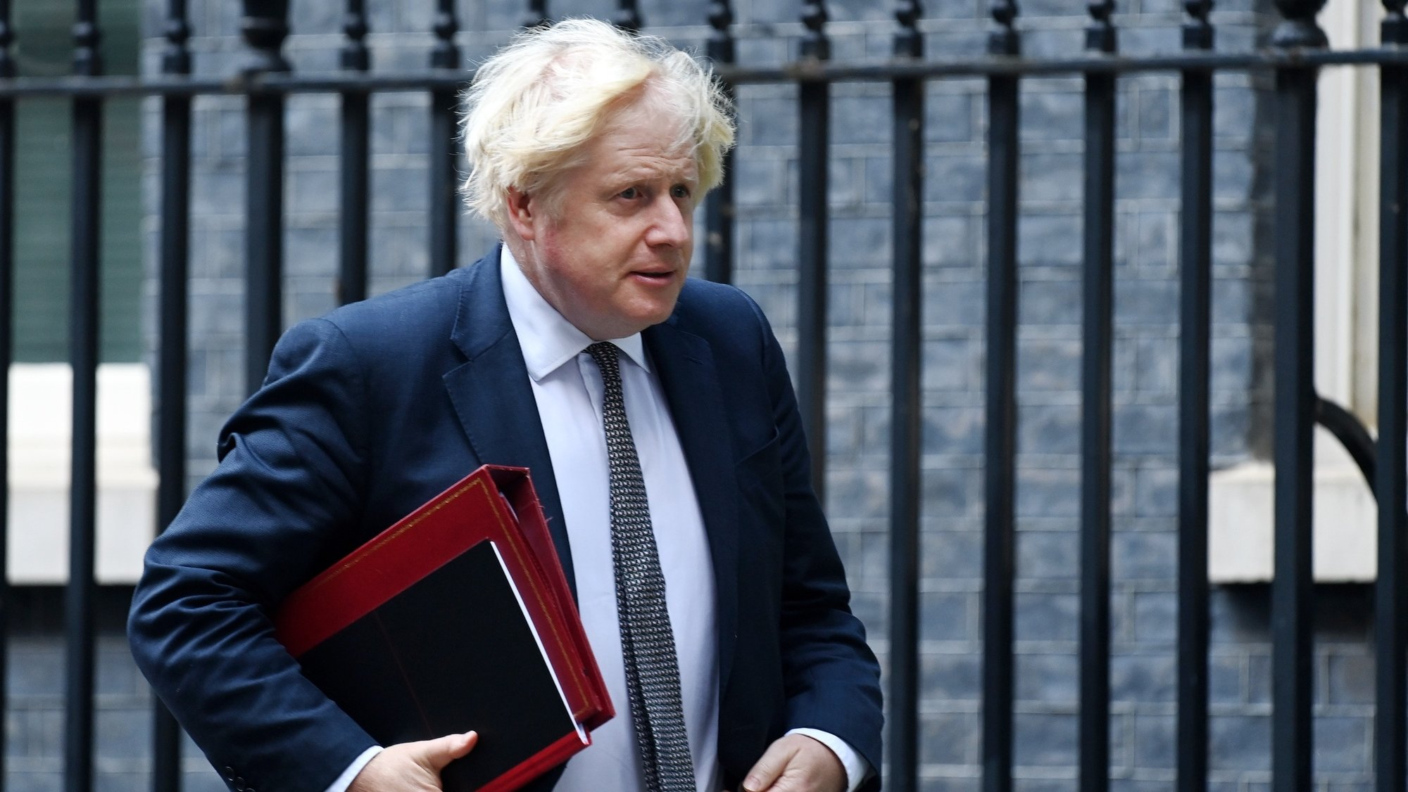 epa09427556 British Prime Minister Boris Johnson departs 10 Downing Street in London, Britain, 24 August 2021. Johnson is set to push US President Biden for a troop withdrawal extension in Afghanistan during an emergency G7 virtual summit meeting scheduled for 24 August.  EPA/ANDY RAIN