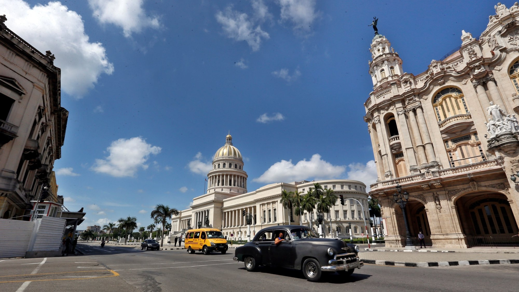 epa09340956 Several cars pass in front of the Capitol in Havana, Cuba, 12 July 2021. The streets of the Cuban capital remain calm one day after the large demonstrations against the government.  EPA/Ernesto Mastrascusa
