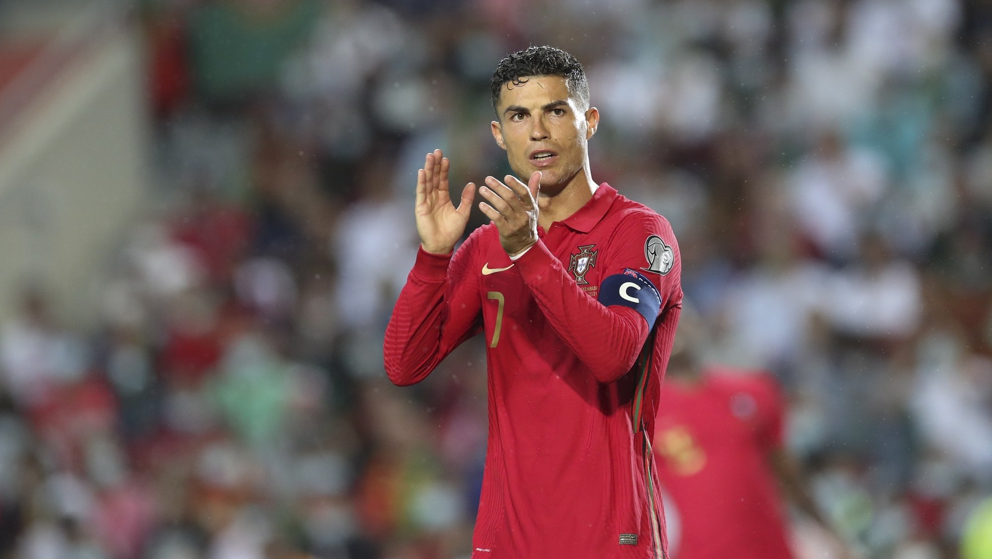 epa09520962 Cristiano Ronaldo of Portugal reacts during the FIFA World Cup 2022 qualifying group A soccer match at Algarve Stadium in Loule, Portugal, 12 October 2021.  EPA/ANTONIO COTRIM