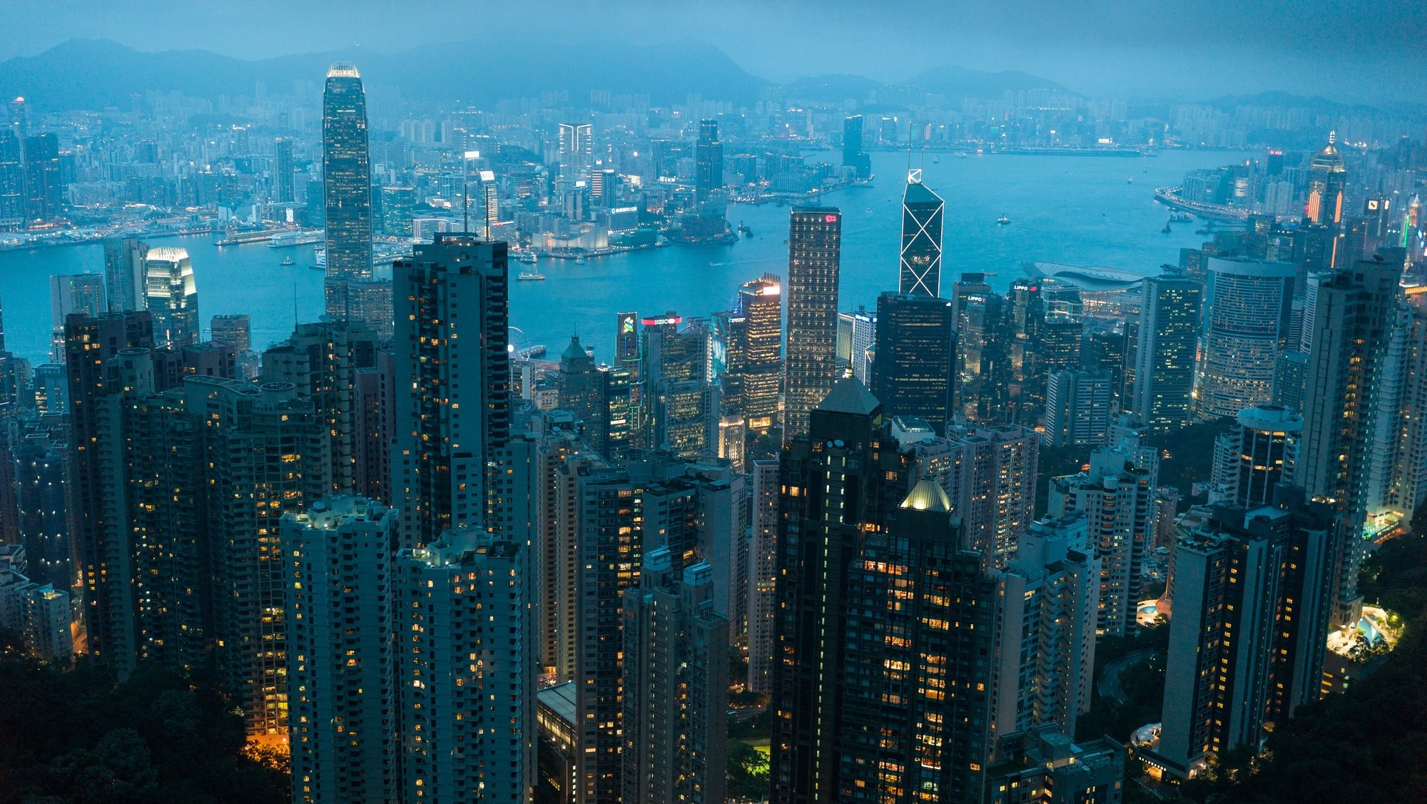 epa06029550 A view from commercial and residential buildings on both sides of the Victoria Harbour in Hong Kong, China, 15 June 2017. Hong Kong will celebrate the 20th anniversary of its handover from Britain to China on 01 July.  EPA/JEROME FAVRE