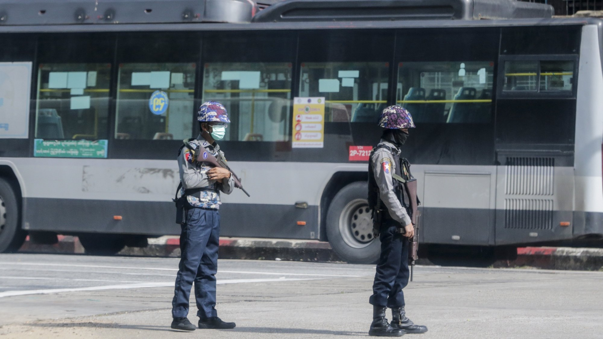 epa09408114 Armed policemen stand guard as they block a road after several explosions occurred at downtown area in Yangon, Myanmar, 10 August 2021. Reports indicate at least five explosions occurred in the afternoon of 10 August. No casualties or injuries reported by authority.  EPA/STRINGER