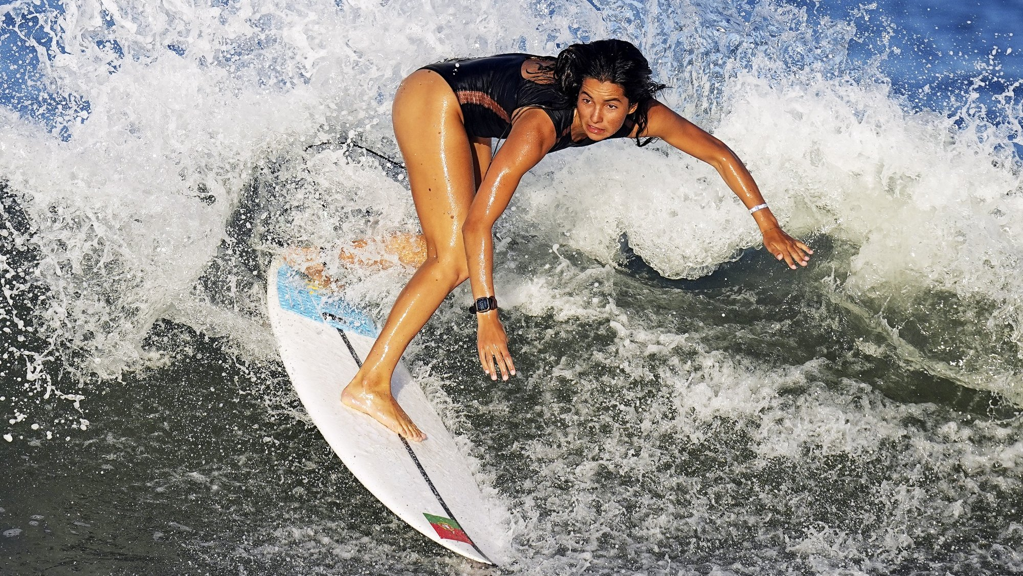 epa09361491 Teresa Bonvalot from Portugal surfs during a training session at the Tsurigasaki Surfing Beach, Ichinomiya, Japan 24 July 2021. Surfing will debut as an Olympic sport for the first time in history when competition begins on 25 July 2021.  EPA/NIC BOTHMA