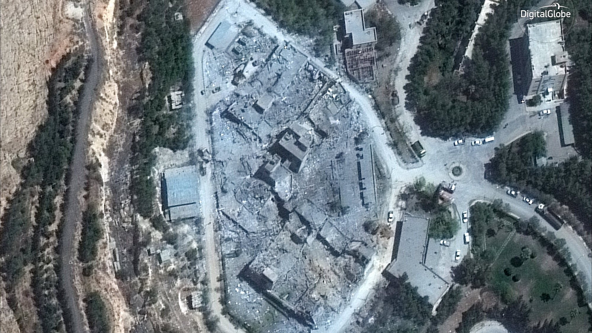 epa06672550 A handout satellite photo made available by 15 April 2018 by DigitalGlobe, showing the Barzah Research and Development Center in Damascus, Syria, after the attack by coalition forces missiles and rockets early 14 April 2018. US, France, and Britain launched strikes against Syria on 14 April 2018 in response to Syria's suspected chemical weapons attack.  EPA/DIGITALGLOBE HANDOUT (Satellite image © 2018 DigitalGlobe, a Maxar company.) HANDOUT EDITORIAL USE ONLY/NO SALES