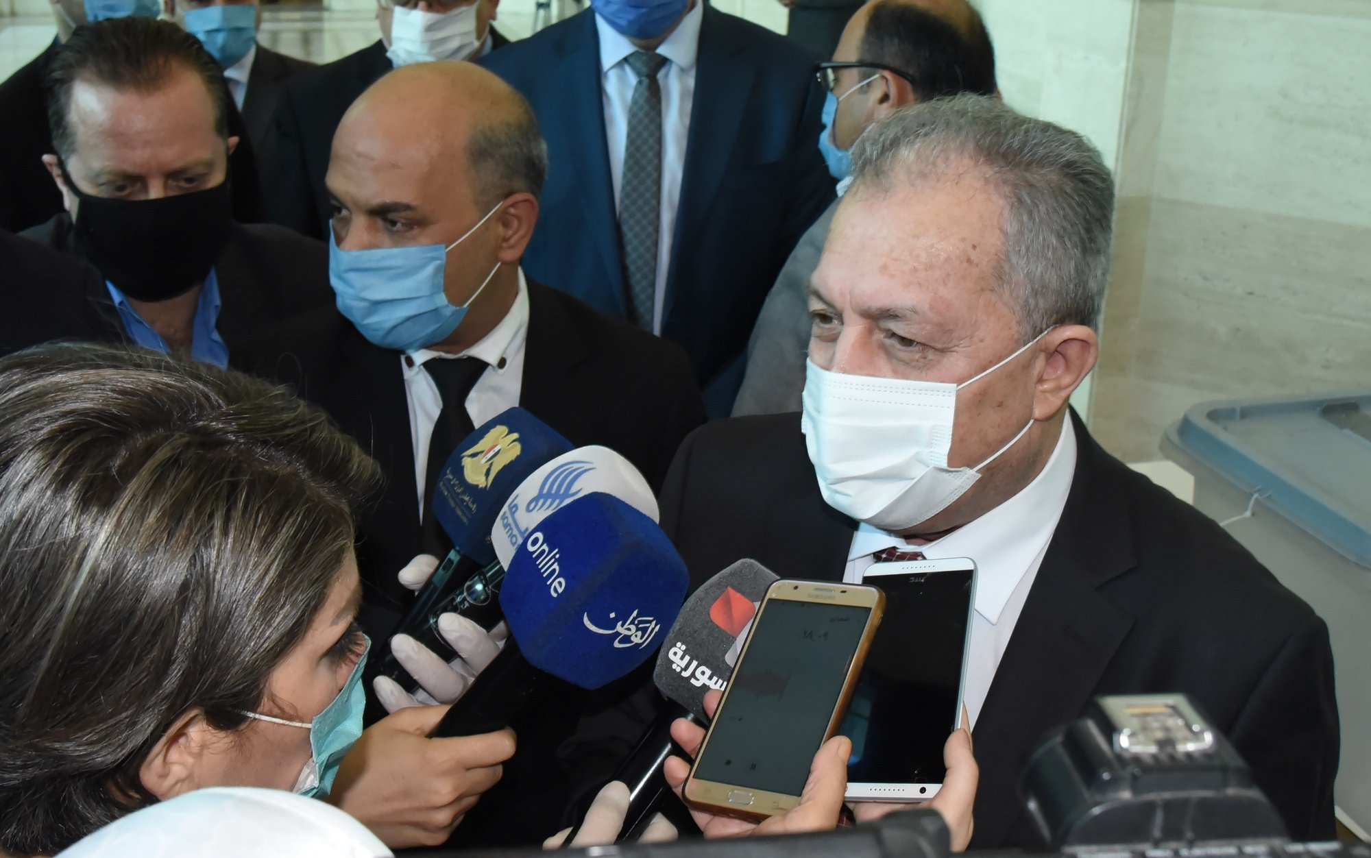 epa08554661 Syrian Prime Minister Hussein Arnous speaks to reporter after casting his vote in the People's Assembly (parliament) elections in Damascus, Syria, 19 July 2020. According to reports, 250 Syrian MPs will be elected by direct vote for a four-year term. A total of 1656 candidates are participating in this election process, including 200 women.  EPA/YOUSSEF BADAWI