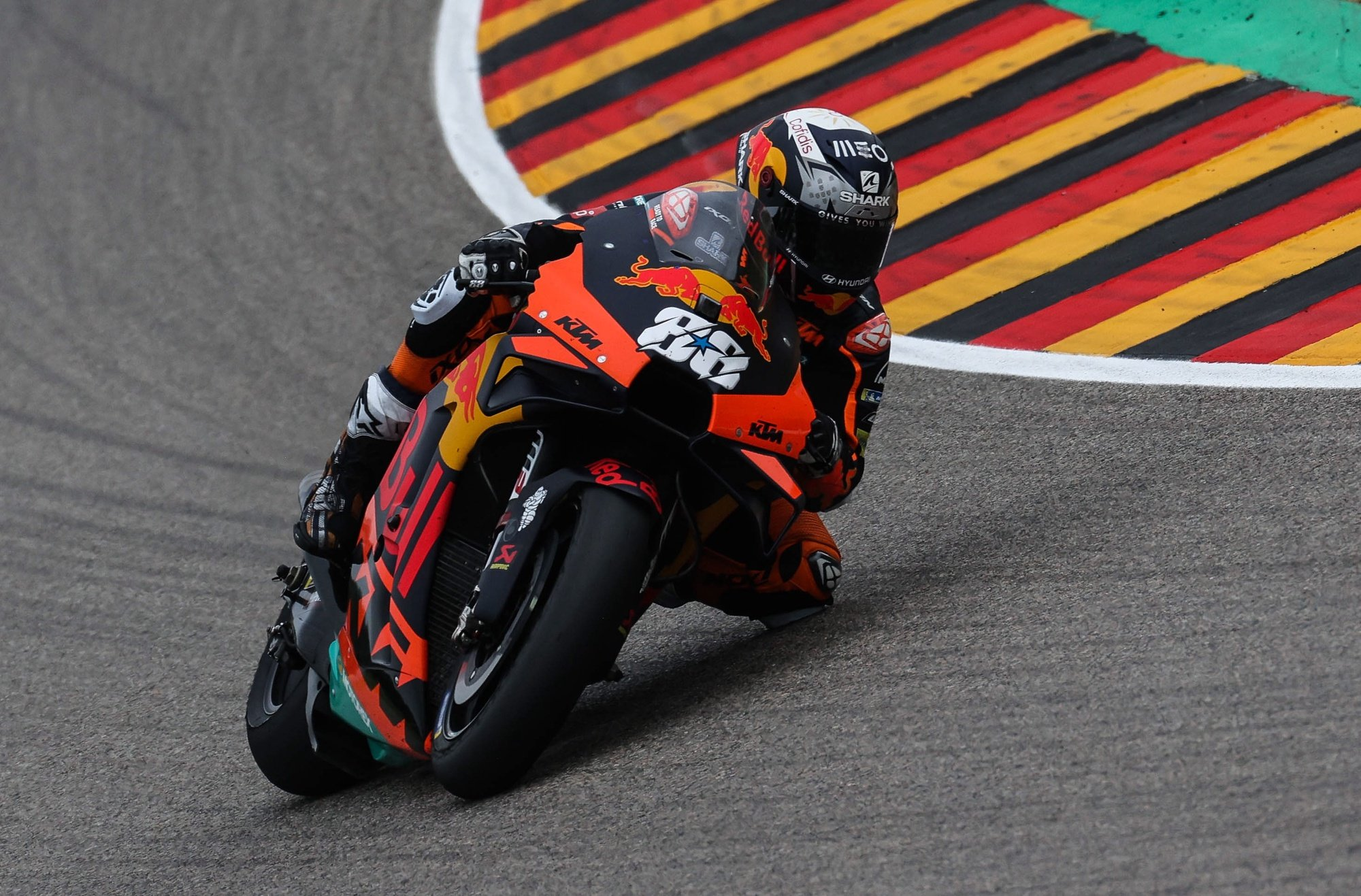 epa09288255 Portuguese MotoGP rider Miguel Oliveira of the Red Bull KTM Factory Racing team is on his way to take the second place in the Motorcycling Grand Prix of Germany at the Sachsenring racing circuit in Hohenstein-Ernstthal, Germany, 20 June 2021.  EPA/FILIP SINGER