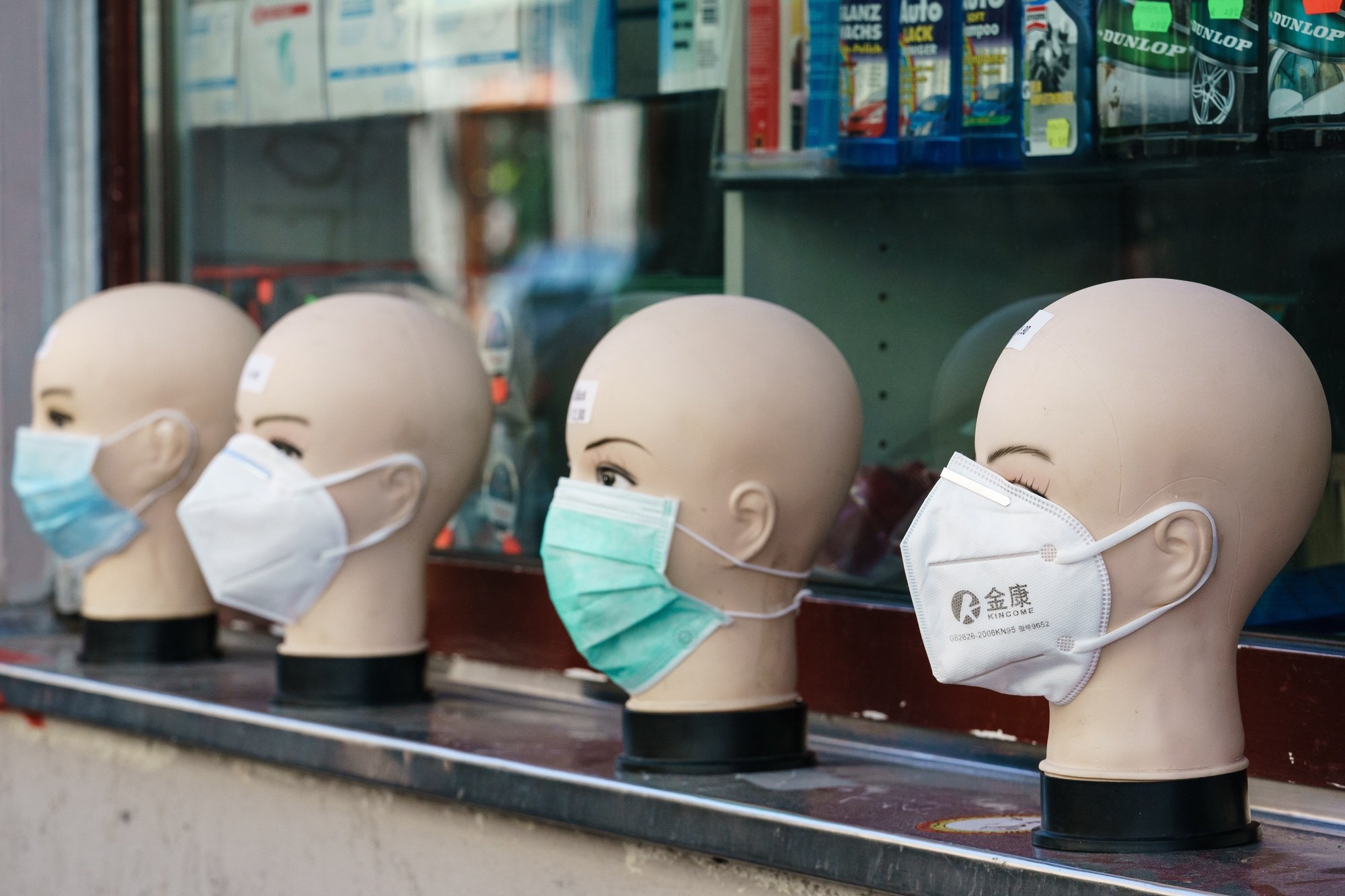 epa08346194 Face masks are on display at a shop in the Berlin district Kreuzberg in Berlin, Germany, 06 April 2020. Due to the ongoing pandemic of the COVID-19 disease caused by the SARS-CoV-2 coronavirus, most of the shops, museums and concert halls in Berlin are closed. Weekly markets, pharmacies, banking institutes, supermarkets, petrol stations and some other shops are still opened. People are allowed to visit parks in gatherings of people containing not more than two persons or as families. Physical training alone is allowed.  EPA/CLEMENS BILAN