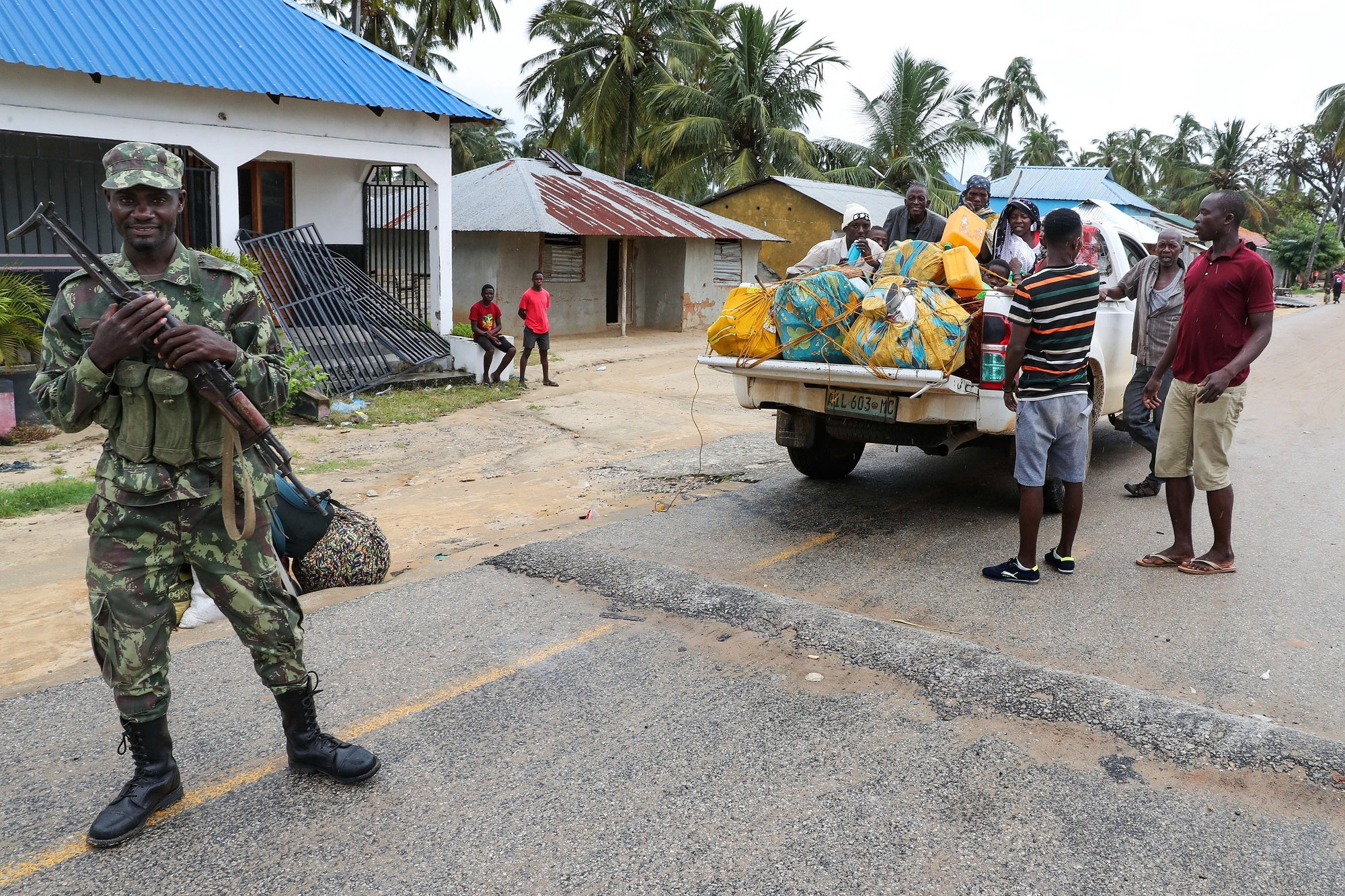 epa09131124 Residents try to return to normality in Palma, Cabo Delgado, Mozambique, 12 April 2021. The violence unleashed more than three years ago in Cabo Delgado province escalated again about two weeks ago, when armed groups first attacked the town of Palma.  EPA/JOAO RELVAS