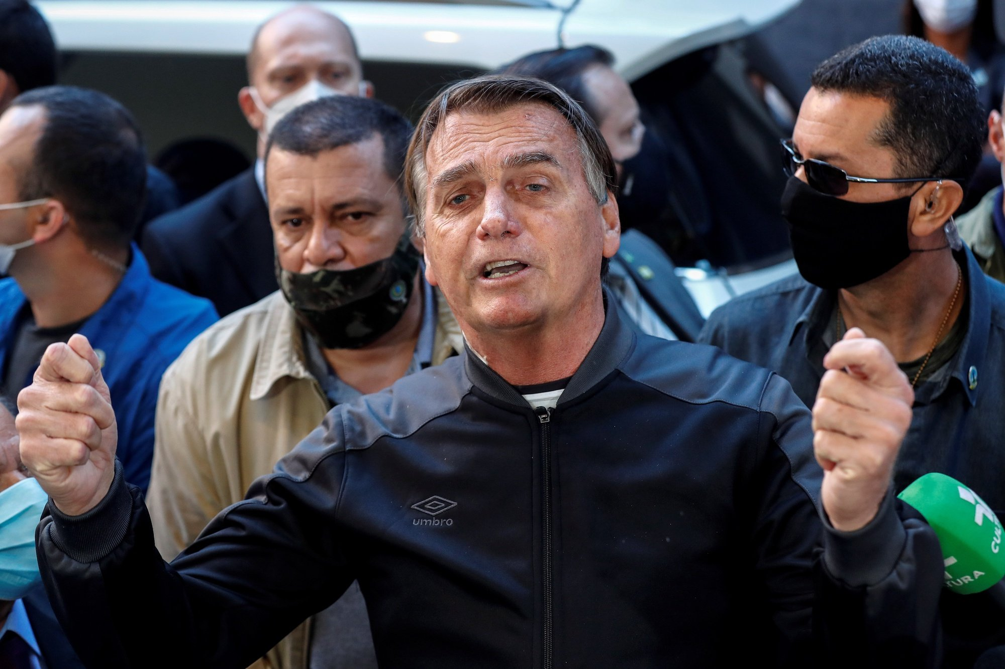 epa09351993 Brazilian President Jair Bolsonaro delivers remarks after he was discharged from Vila Nova Star Hospital, in Sao Paulo, Brazil, 18 July 2021. Bolsonaro was admitted to the Armed Forces Hospital in Brasilia on 14 July for chronic hiccups and abdominal pain and transferred to Sao Paulo the same day to treat an intestinal obstruction.  EPA/Sebastiao Moreira