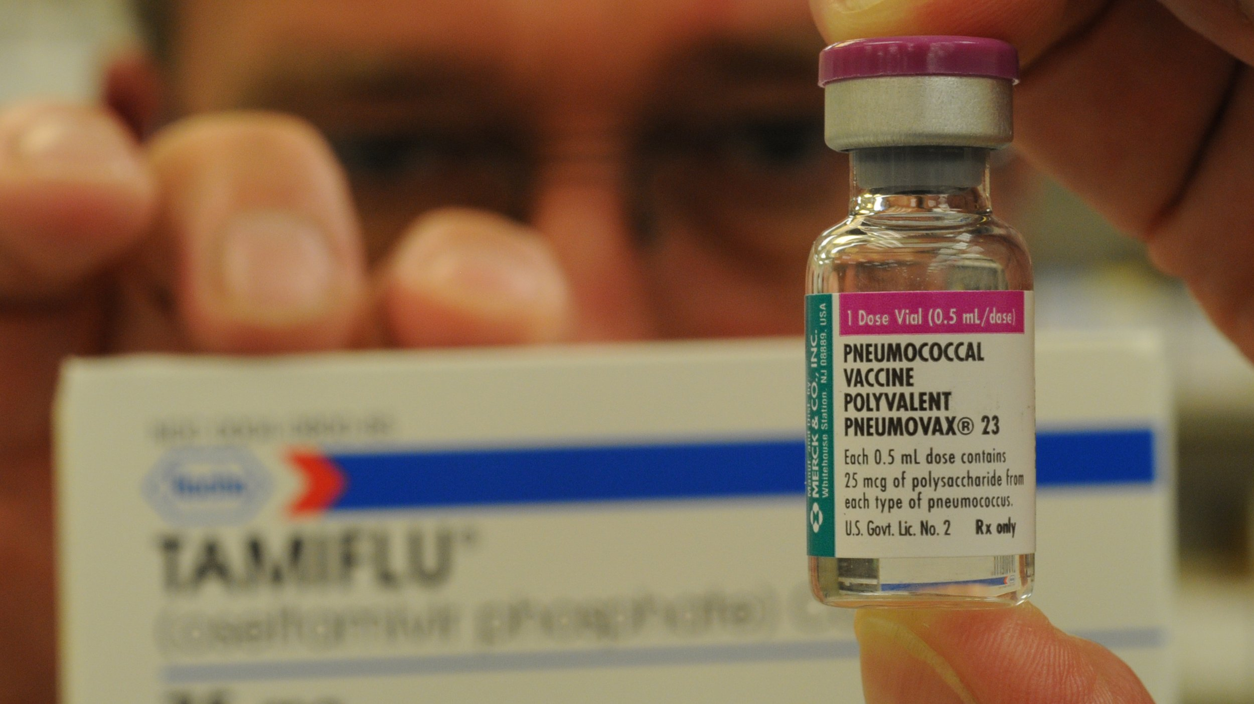 """Reading Hospital Pharmacy Superviser James Smith Jr. holds a dose of Pneumococcal Vaccine, or  """"Pneumovax"""", a back-up medication for a flu vaccine such as Tamiflu, background.  Photo by Bill Uhrich  8/6/2009"""