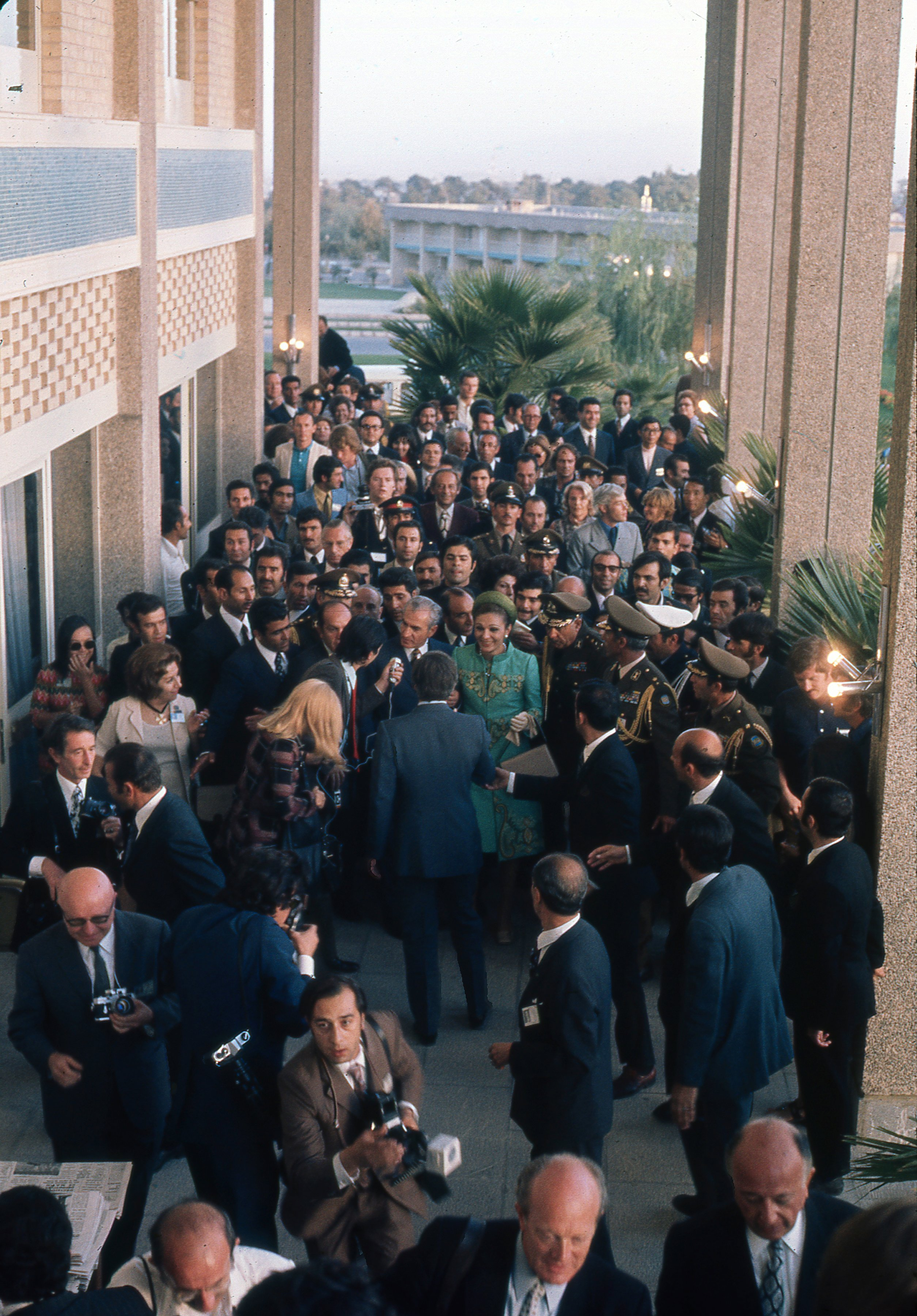 Shah and Shahbanu mingle with officials at celebration of 2500th anniversary of founding of Iranian Empire in trent city erected in ruins of Persepolis and attended by foreign dignitaries in October 1971.