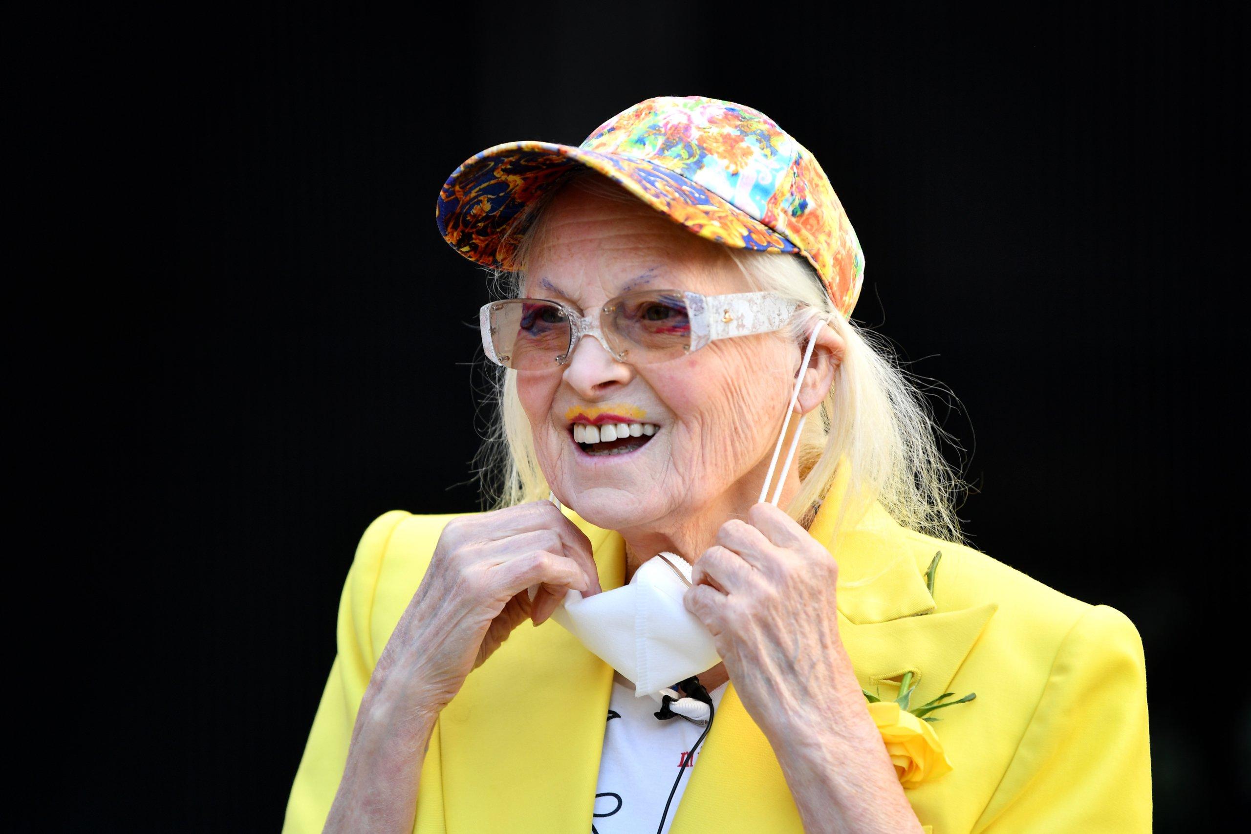 Dame Vivienne Westwood Suspends 10 Ft High Inside Giant Bird Cage In Protest For Julian Assange
