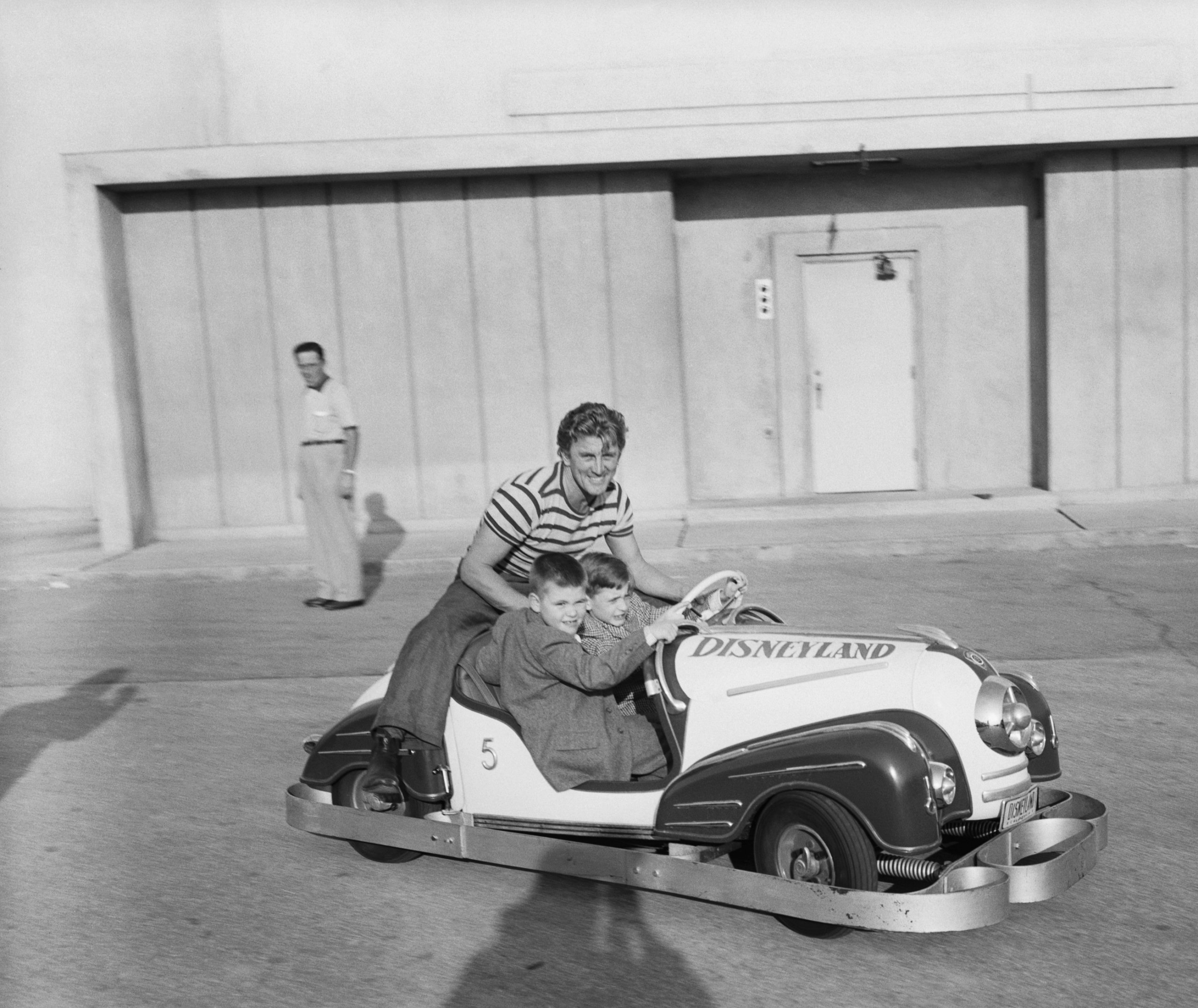 Kirk Douglas and Sons Driving Tiny Car