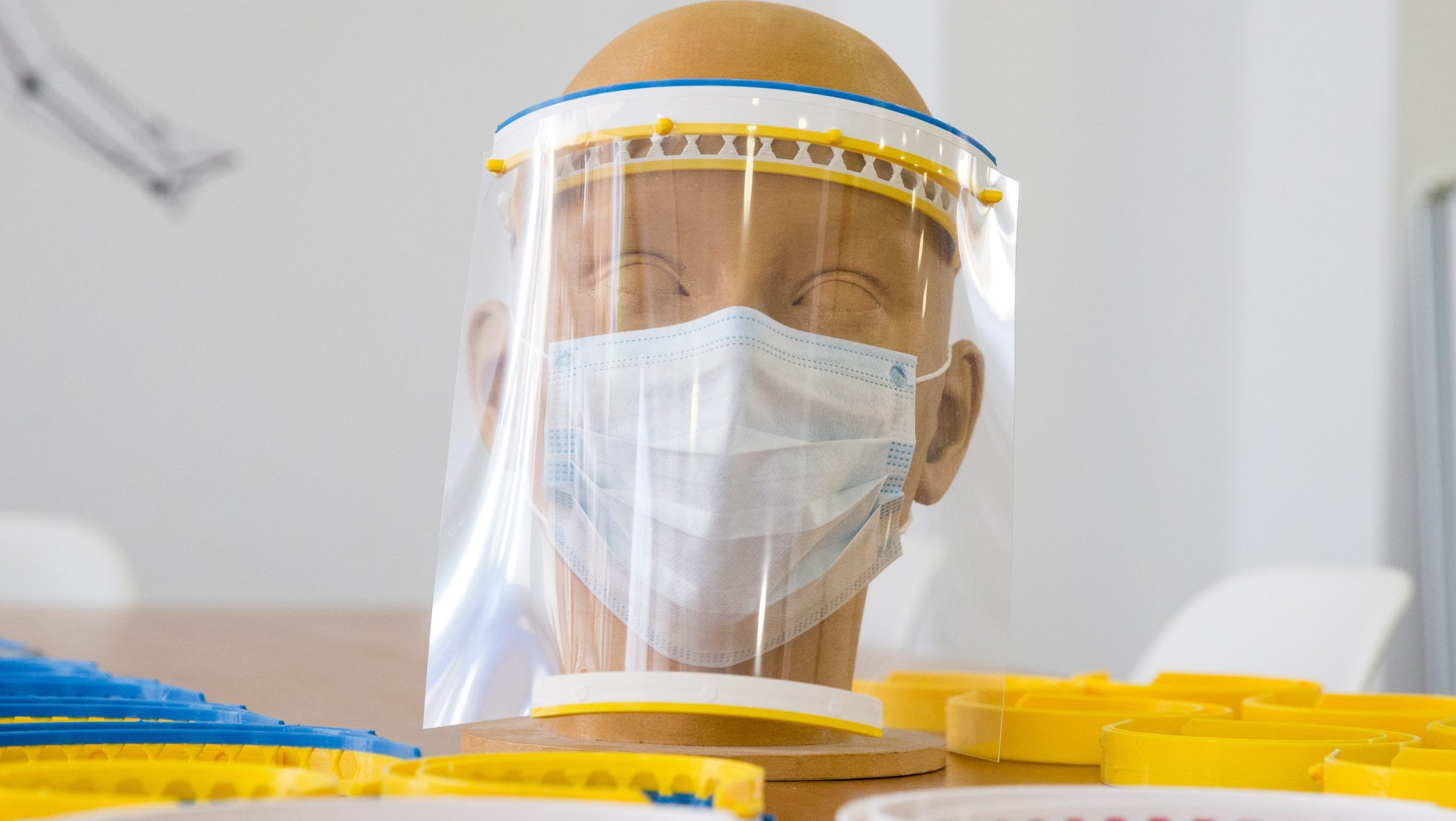 epa08327093 A mask printed in 3D by Nicolas Usuweil, founder of UNIC-3D in Brussels, Belgium, 27 March 2020. Nicolas Usuwiel has completely stopped all his other 3D printing productions to help the medical professions to protect themselves against COVID-19. He sells his production at cost price, making no profit margin on the products sold, he says.  EPA/STEPHANIE LECOCQ