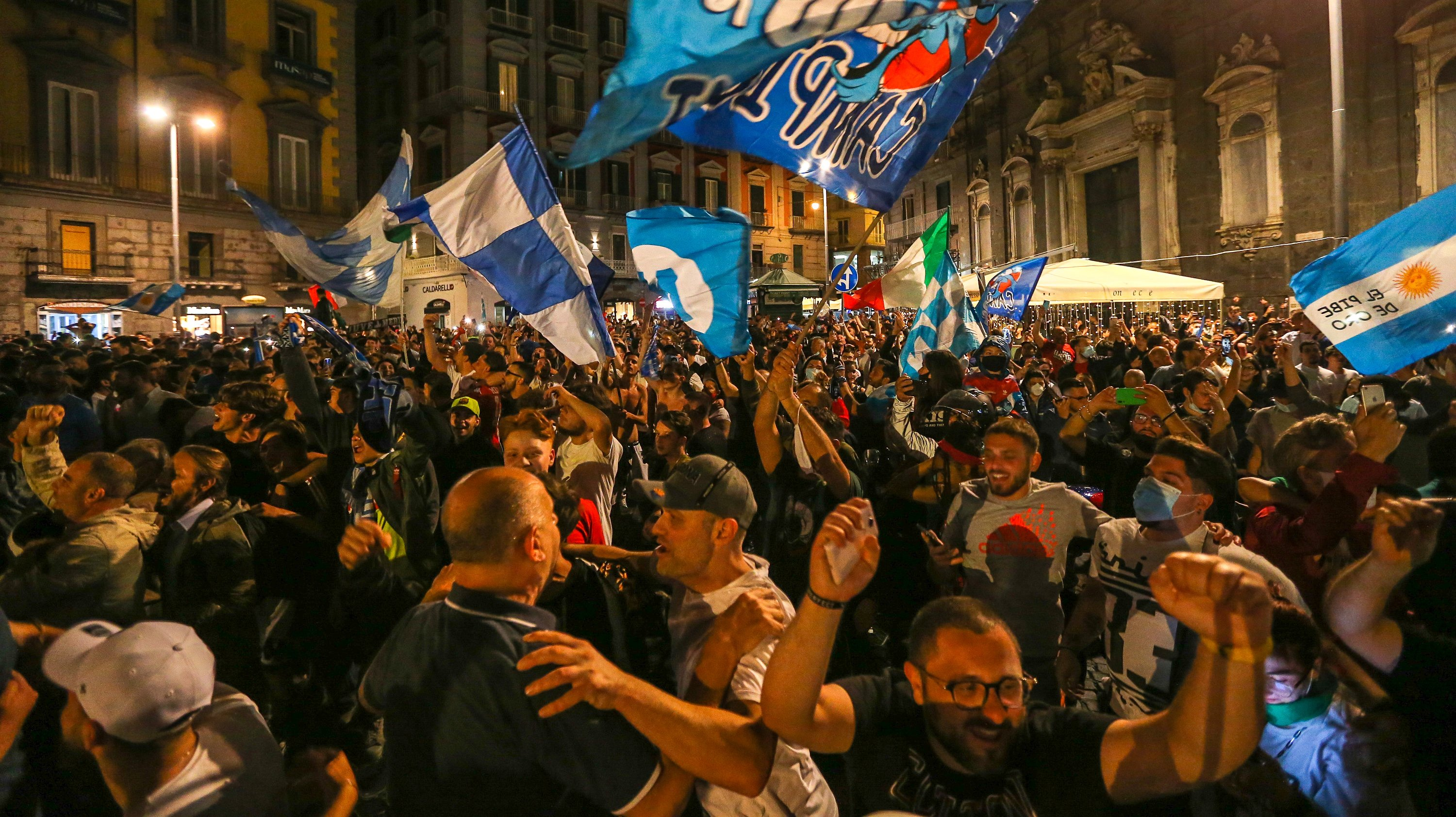 Napoli football fans celebrate the victory of the Italian
