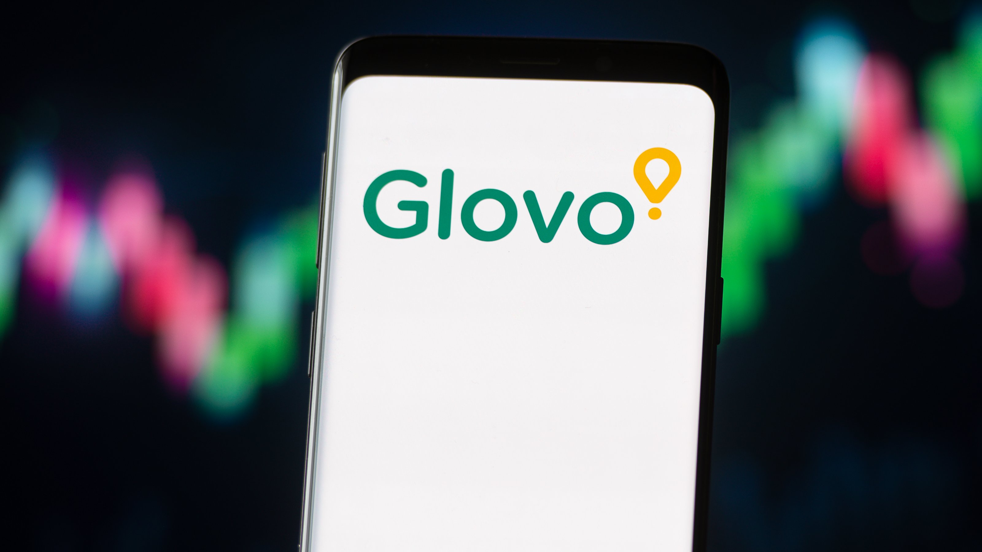 In this photo illustration a Glovo logo seen displayed on a