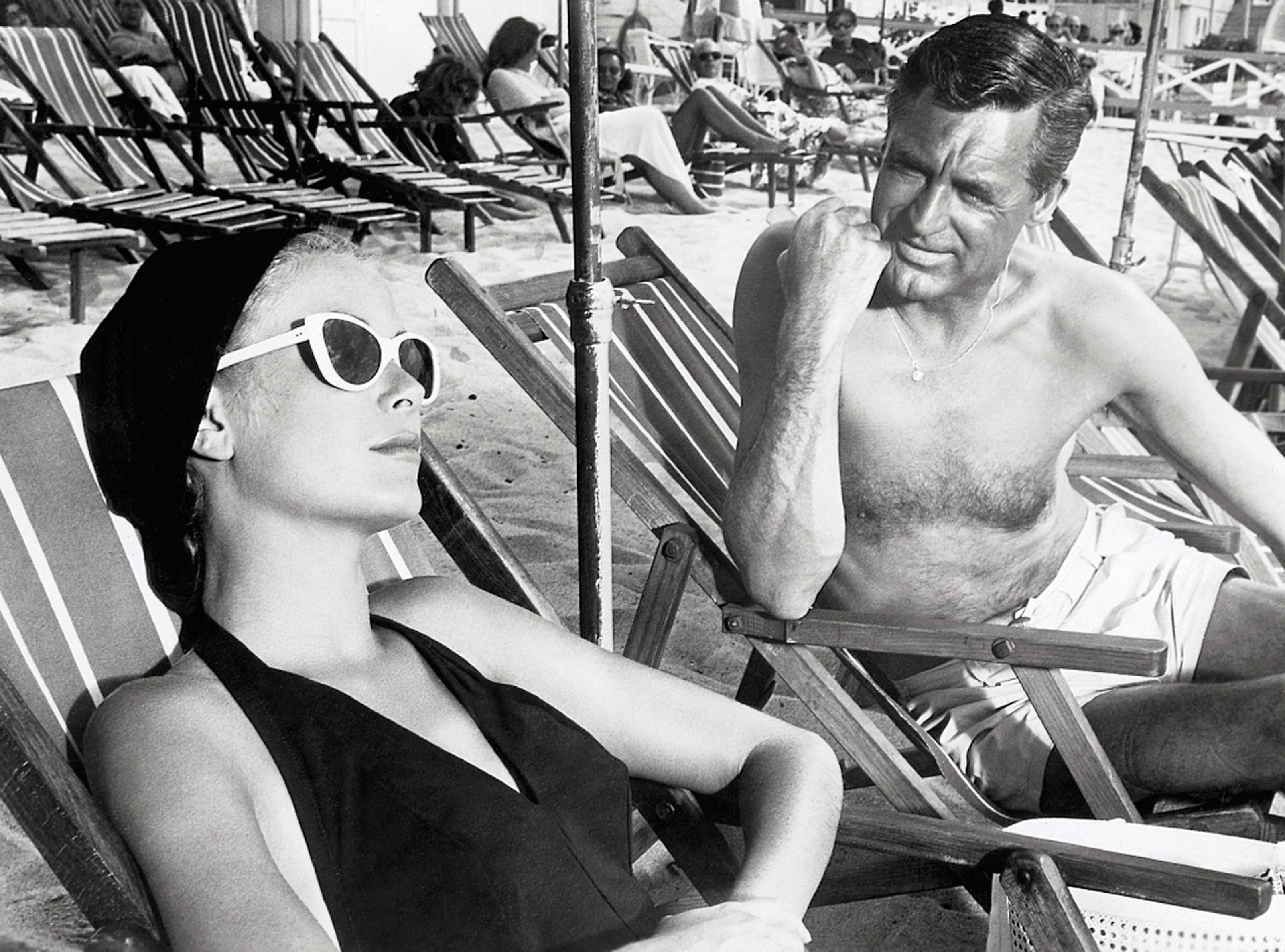 Cary Grant and Grace Kelly Lounging on Beach
