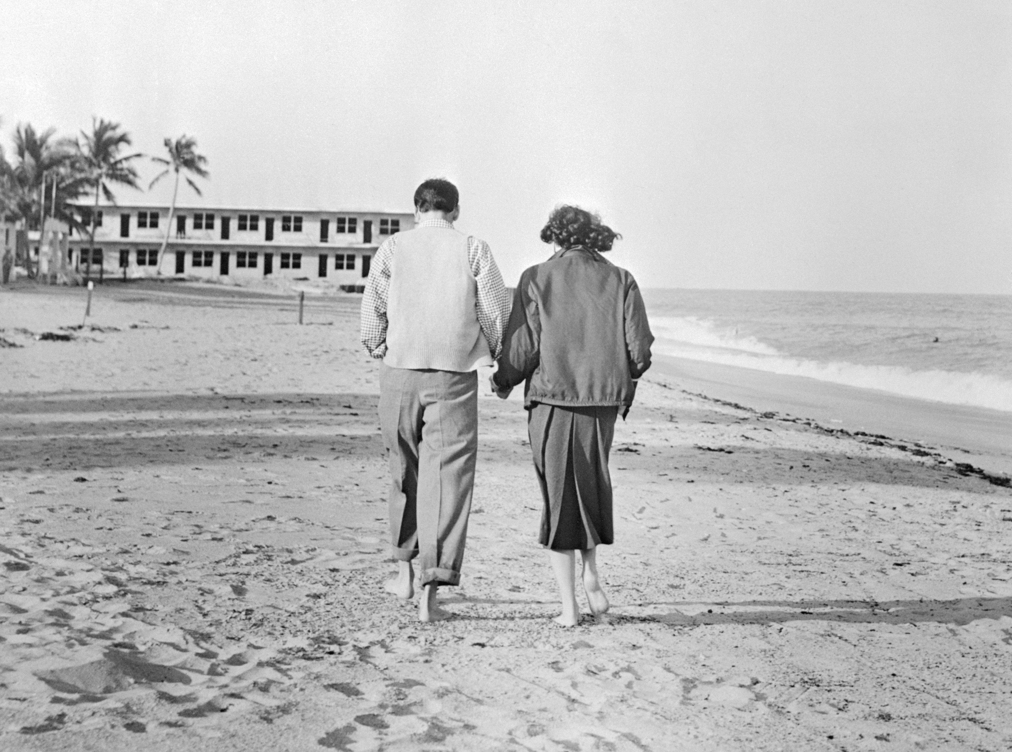 Frank Sinatra and Ava Gardner Walking on Beach
