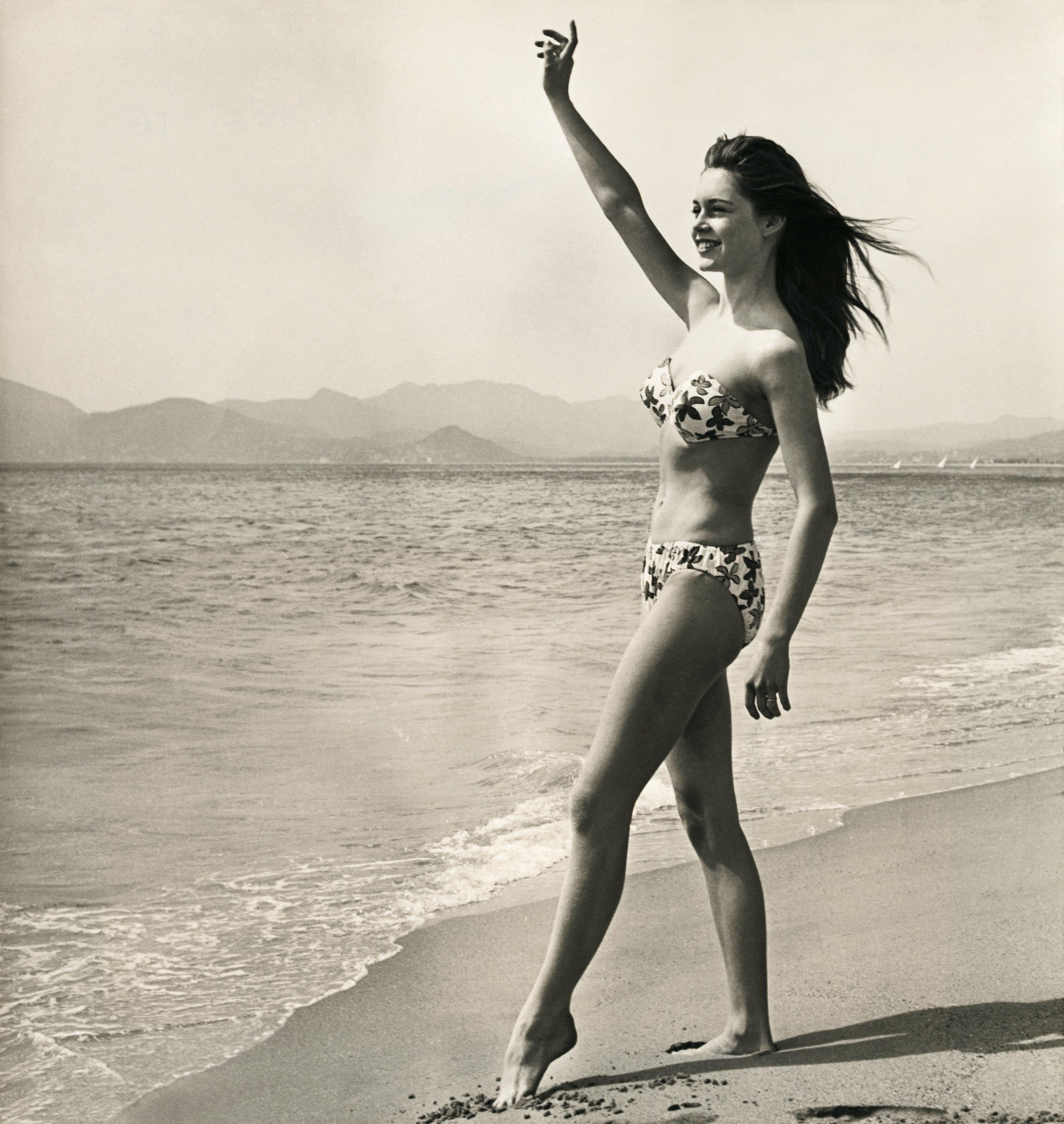 Brigitte Bardot Waving on the Beach