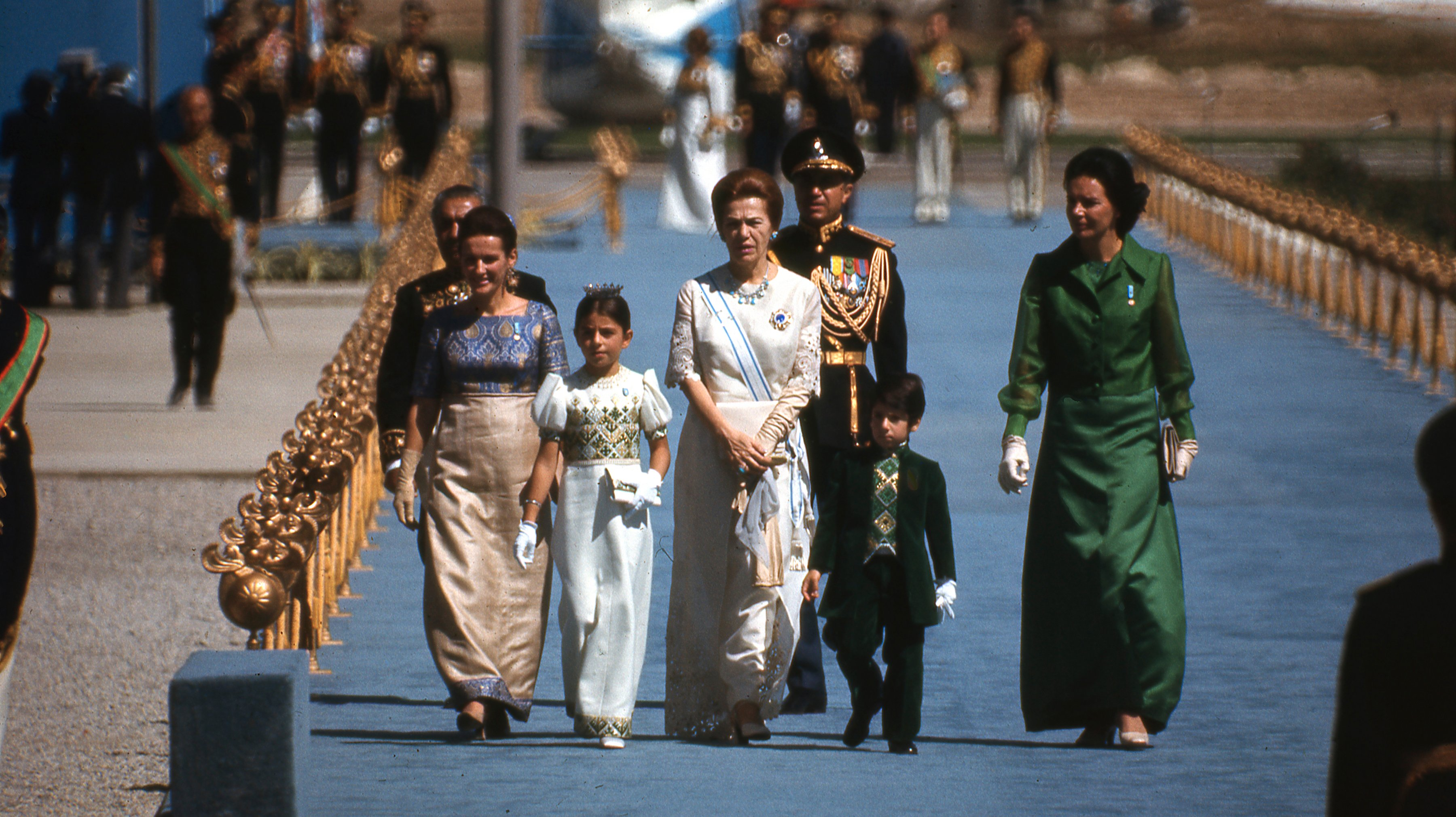 Shah of Iran's mother and children arrive in Persepolis for celebration of 2500th anniversary of founding of Iranian Empire in trent city erected in ruins of Persepolis and attended by foreign dignitaries in October 1971.