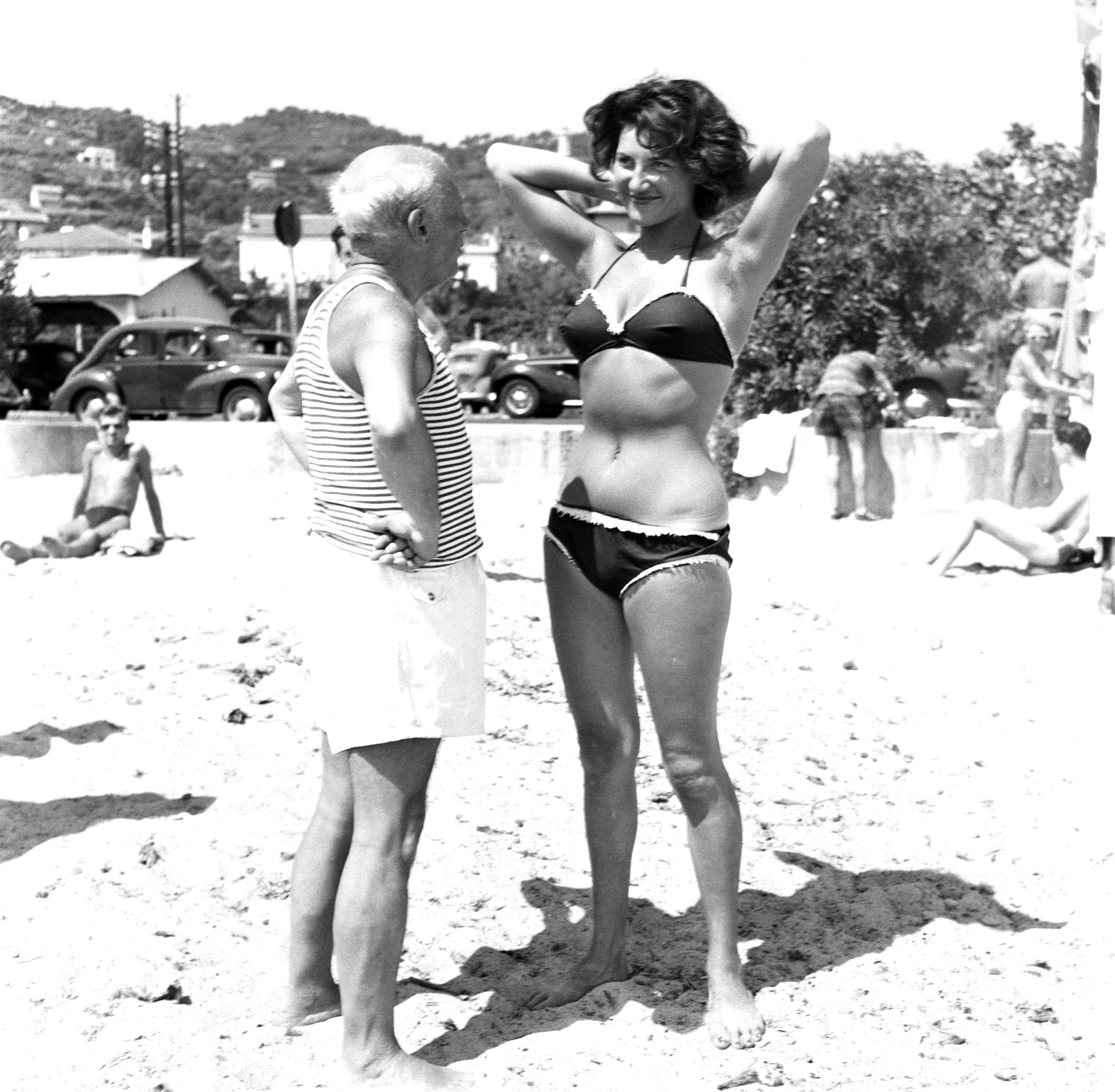 Picasso And Bikini-Clad Woman On The Beach