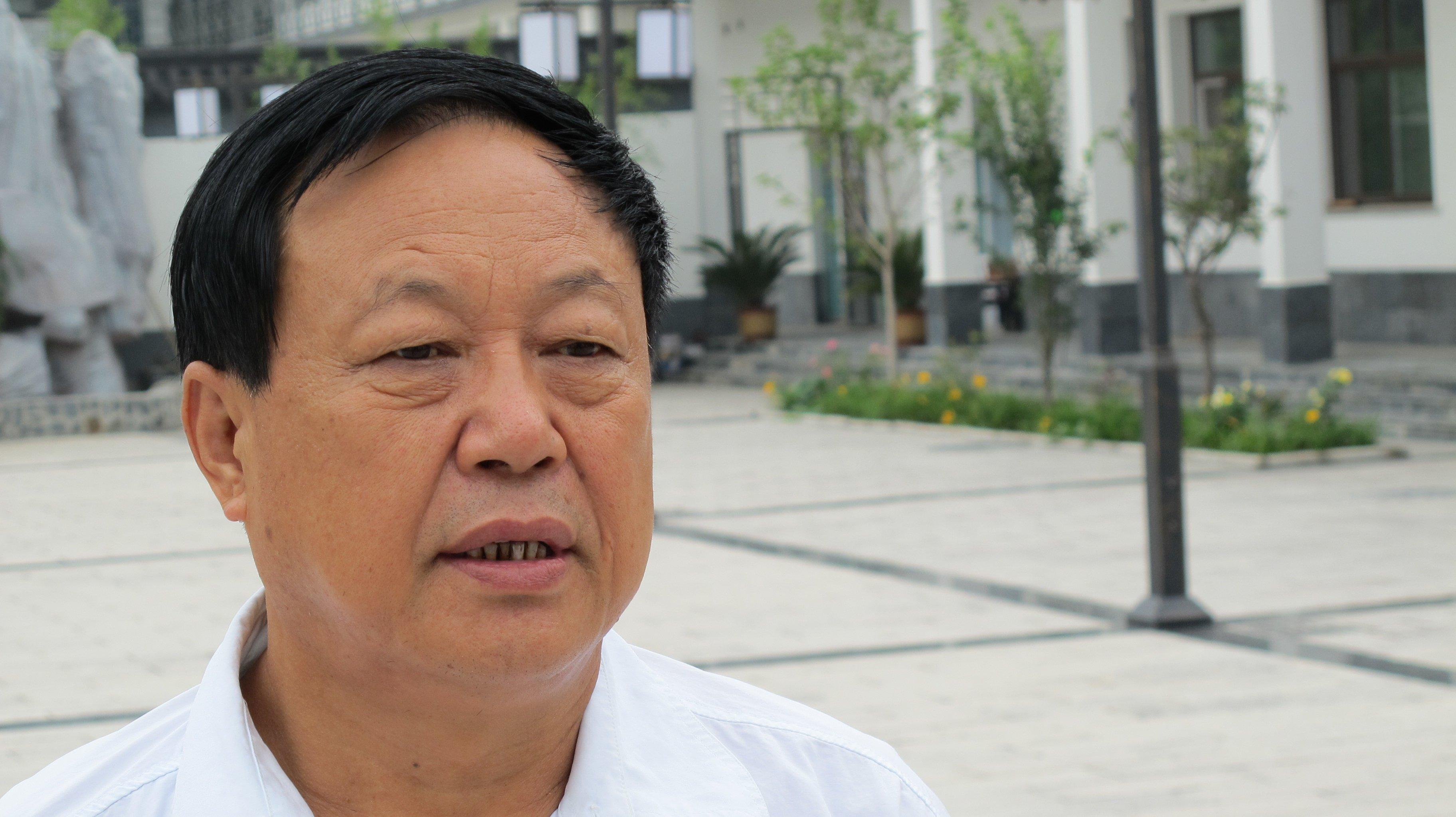 BAODING, CHINA - AUGUST 1: Chinese businessman Sun Dawu talks i