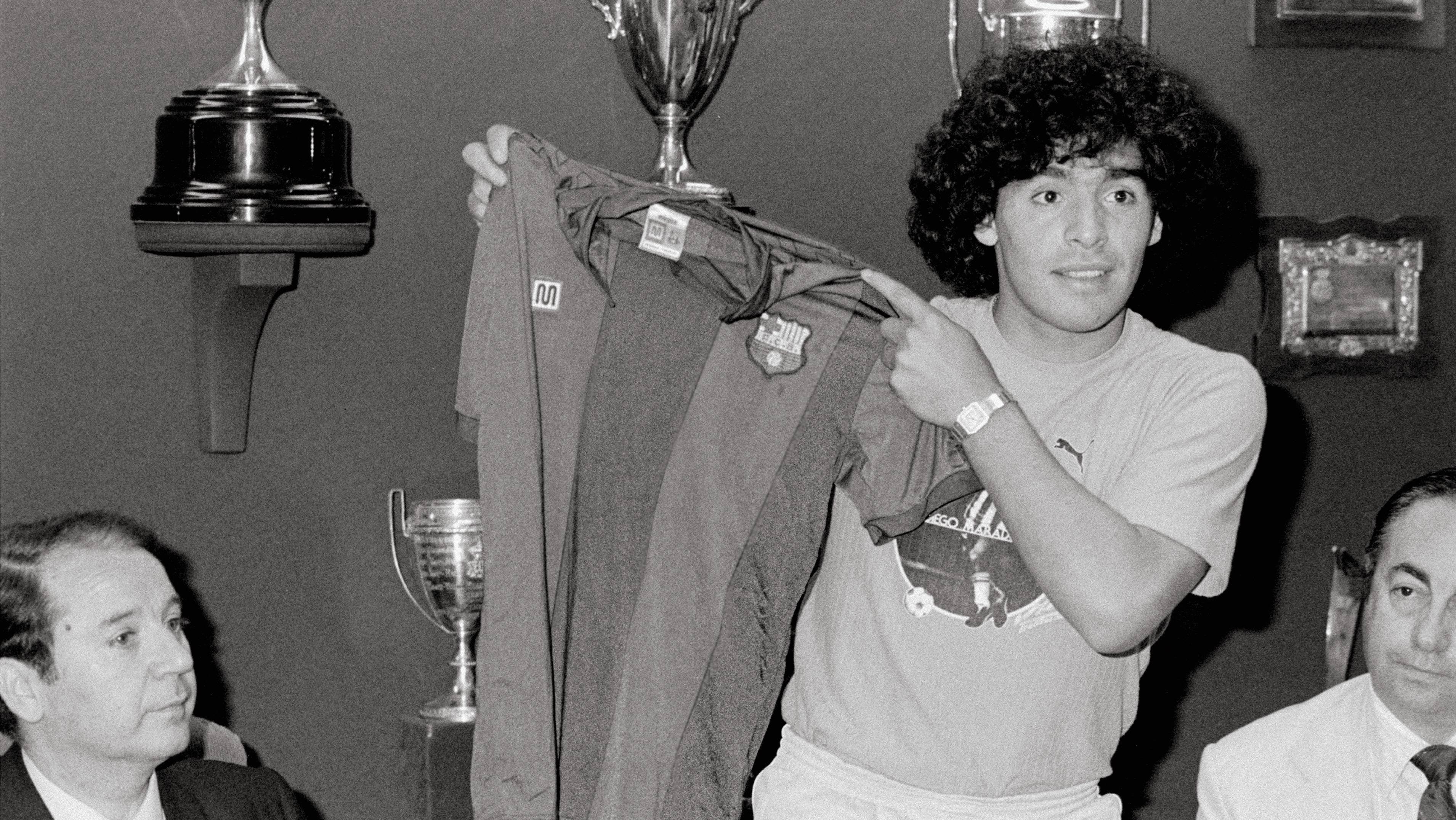 Presentation of Maradona in F.C. Barcelona The Argentinian football star Diego Armando 'Pelusa' Maradona shows the F.C. Barcelona´s singlet in the presence of Jose Luis Nunez, president of the football club, during a press conference