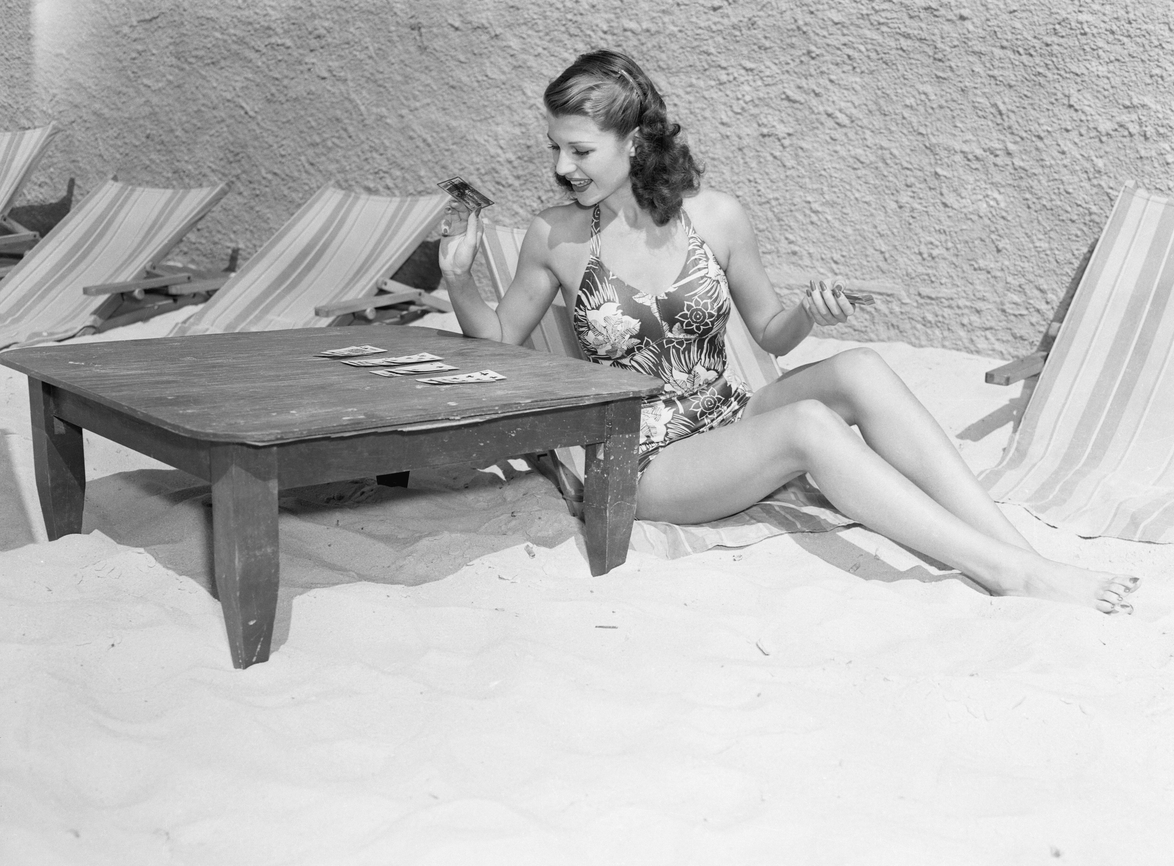 Rita Hayworth Playing Cards at a Beach