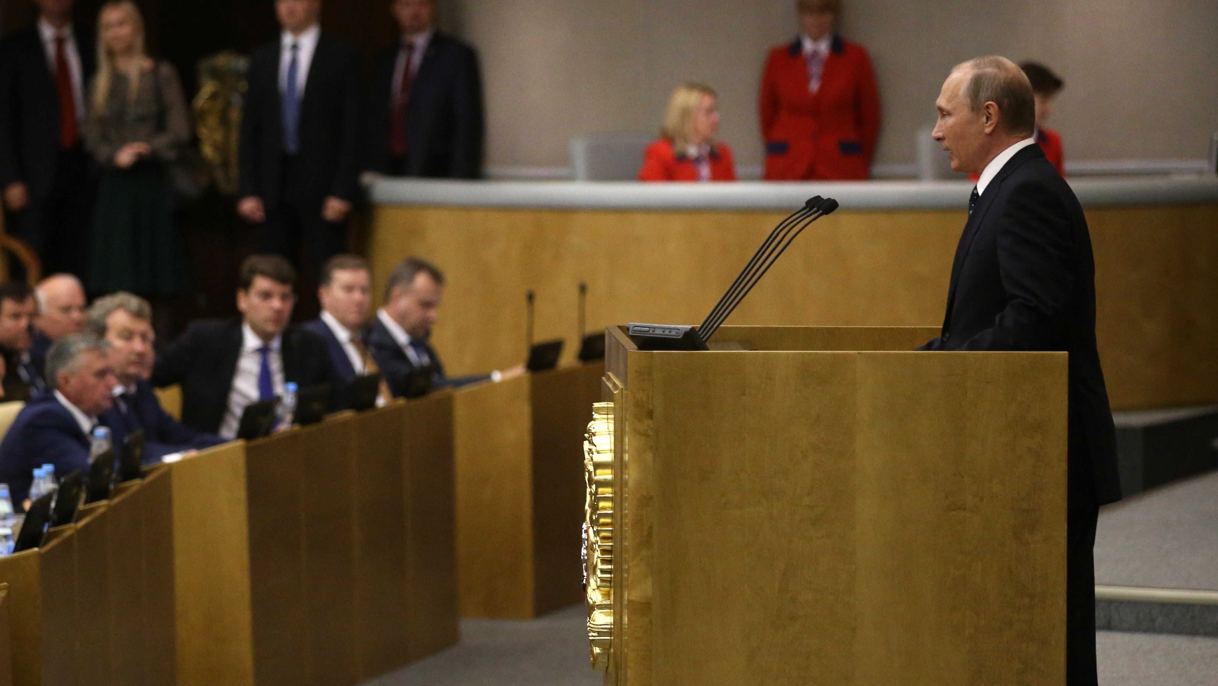 Russian President Vladimir Putin attends the first plenary session of newly elected State Duma