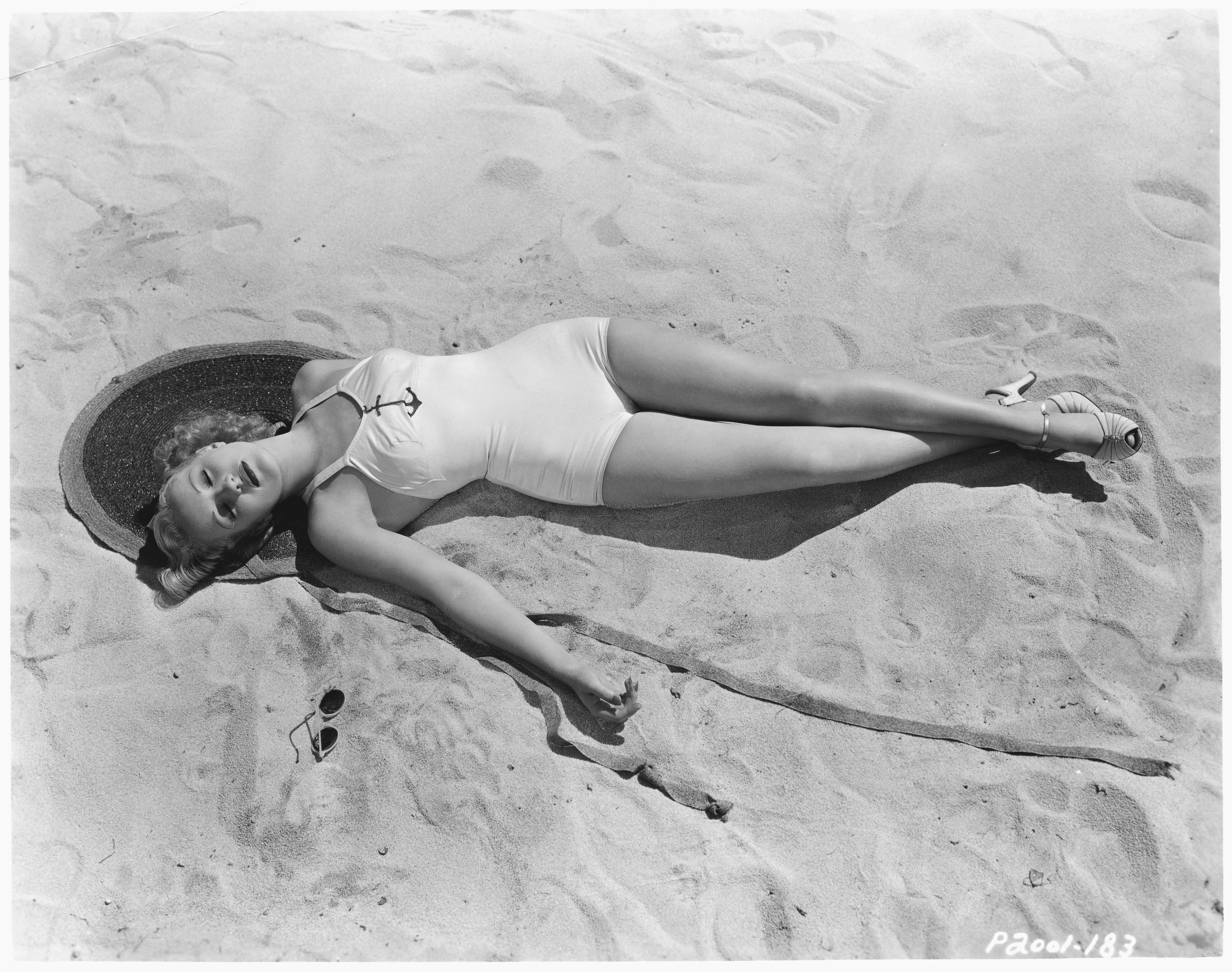 Actress Betty Grable Relaxing on a Beach
