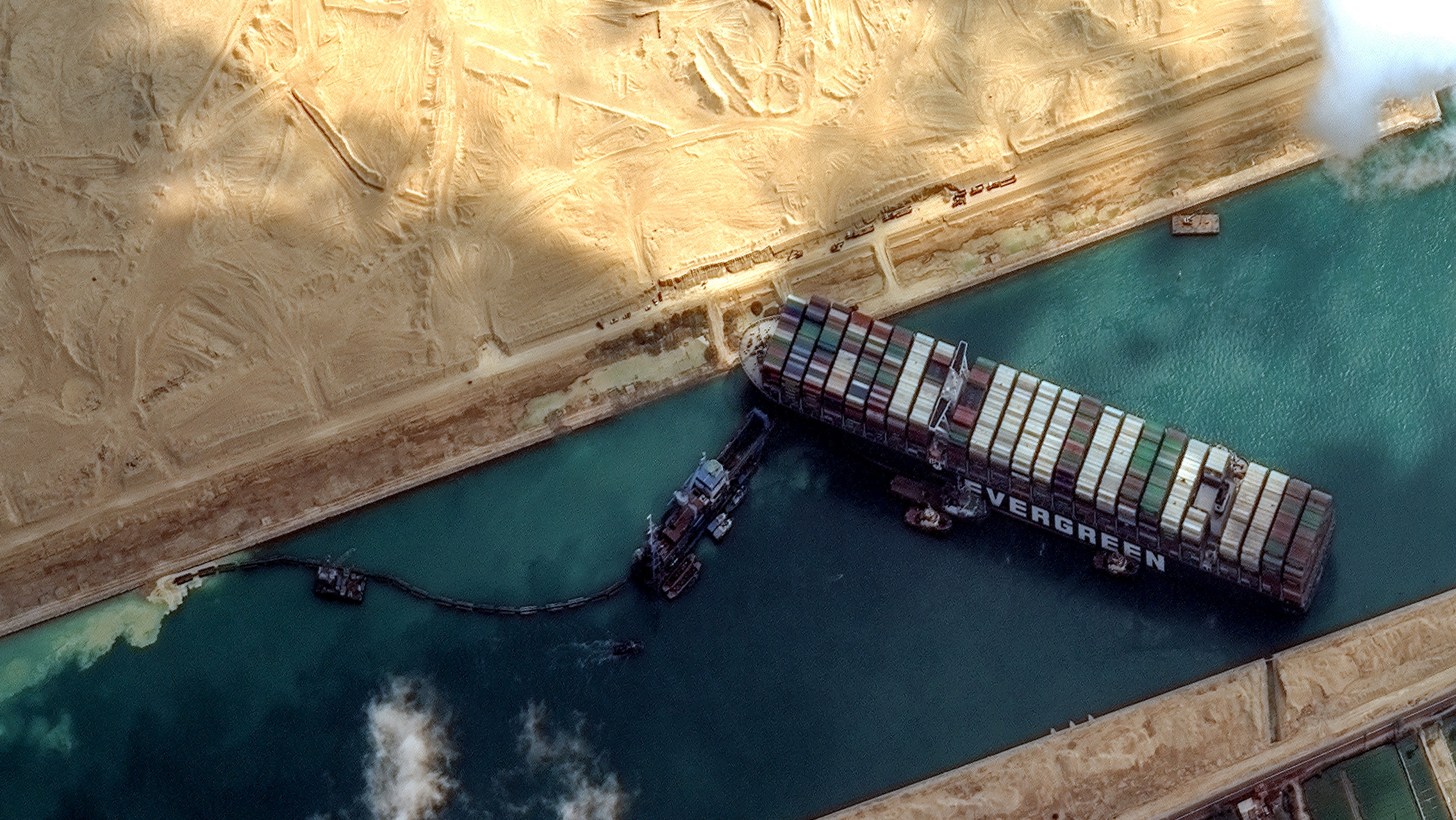 STUCK SHIP EVER GIVEN, SUEZ CANAL -- MARCH 26, 2021:  Maxars WorldView-2 collected new high-resolution satellite imagery of the Suez canal and the container ship (EVER GIVEN) that remains stuck in the canal north of the city of Suez, Egypt.