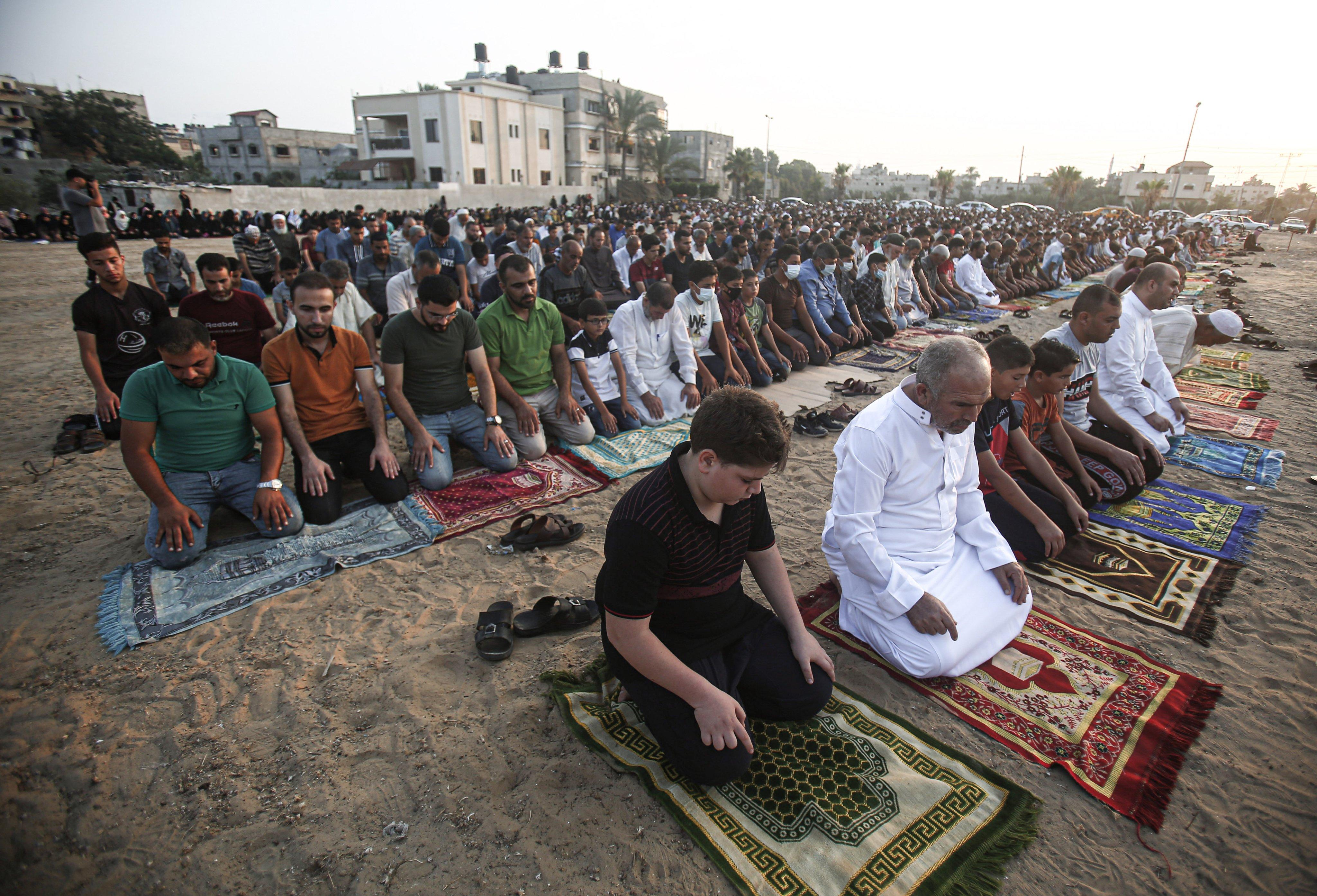 """Palestinian Muslims perform Eid al-Adha prayers in a """"yard"""""""