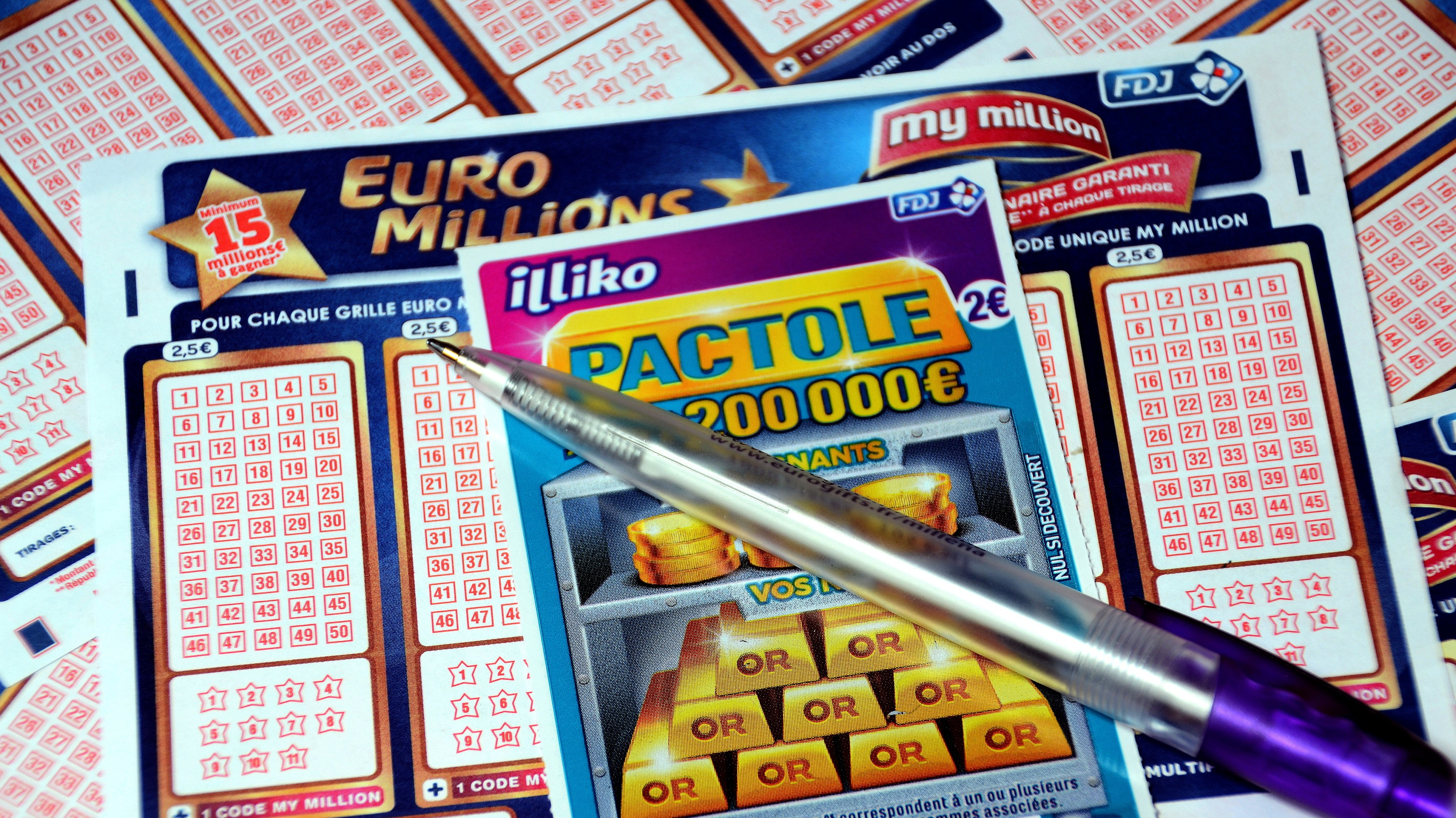 In this photo illustration a pen and a scratch card on