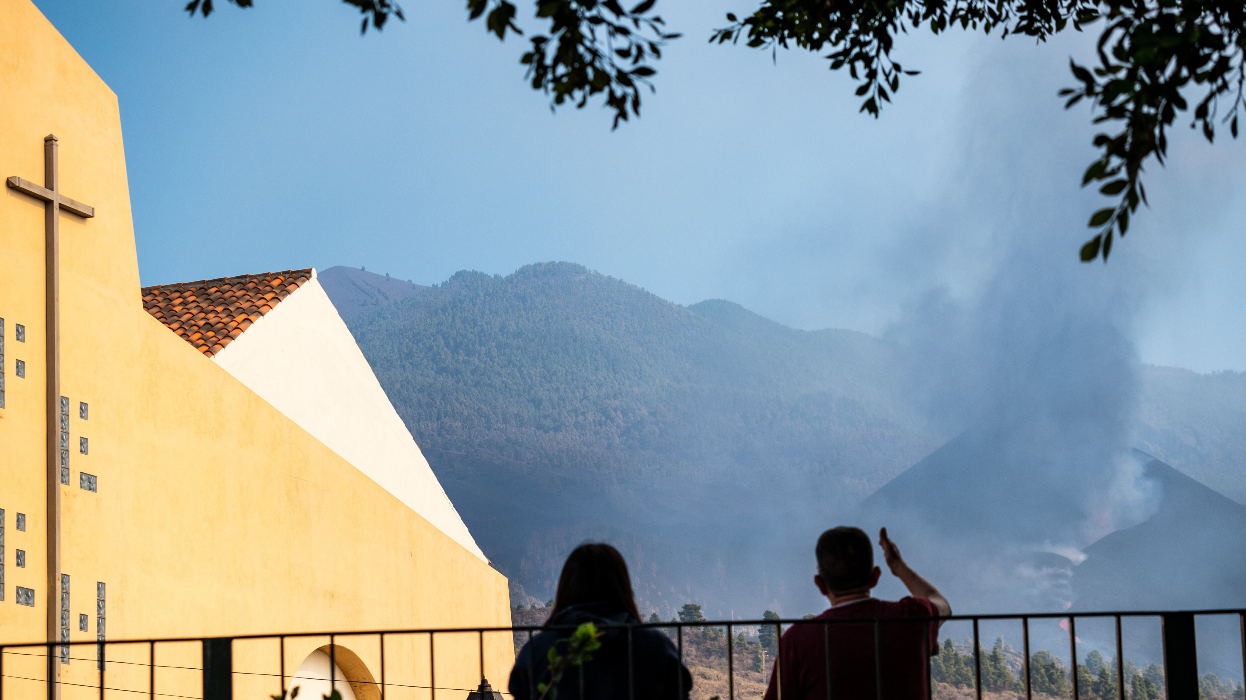 A couple sitting outside the church of Tajuya, watching the