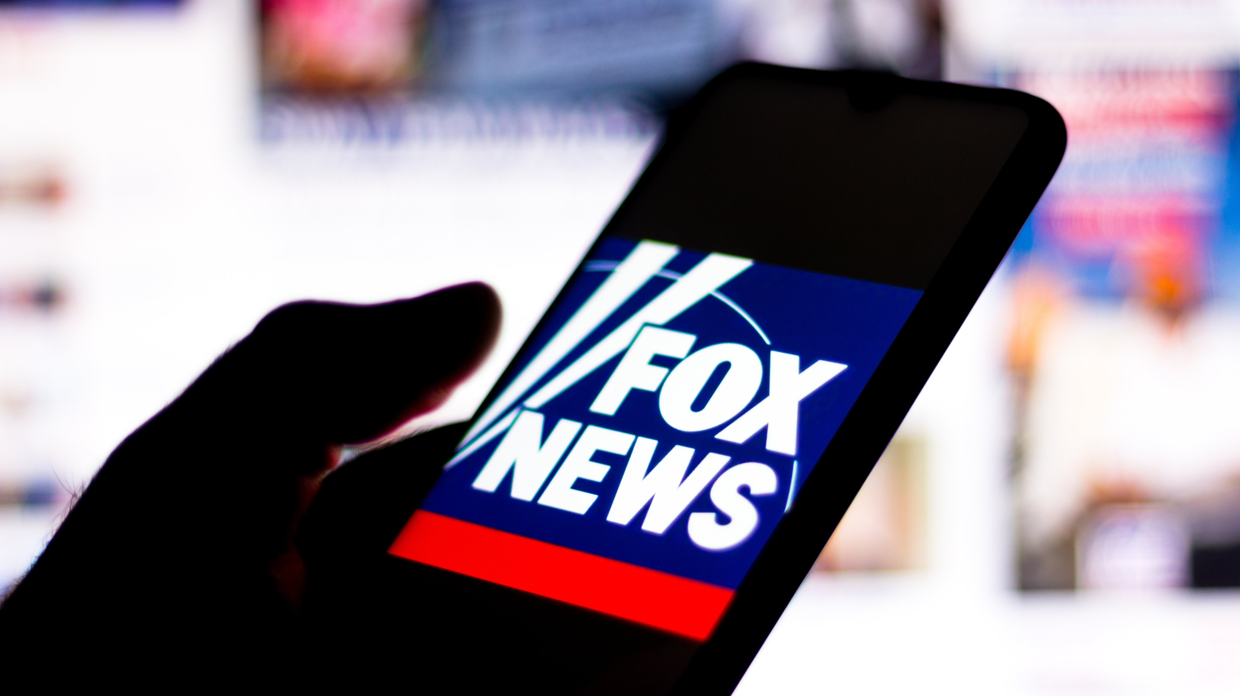 In this photo illustration the Fox News Channel logo seen