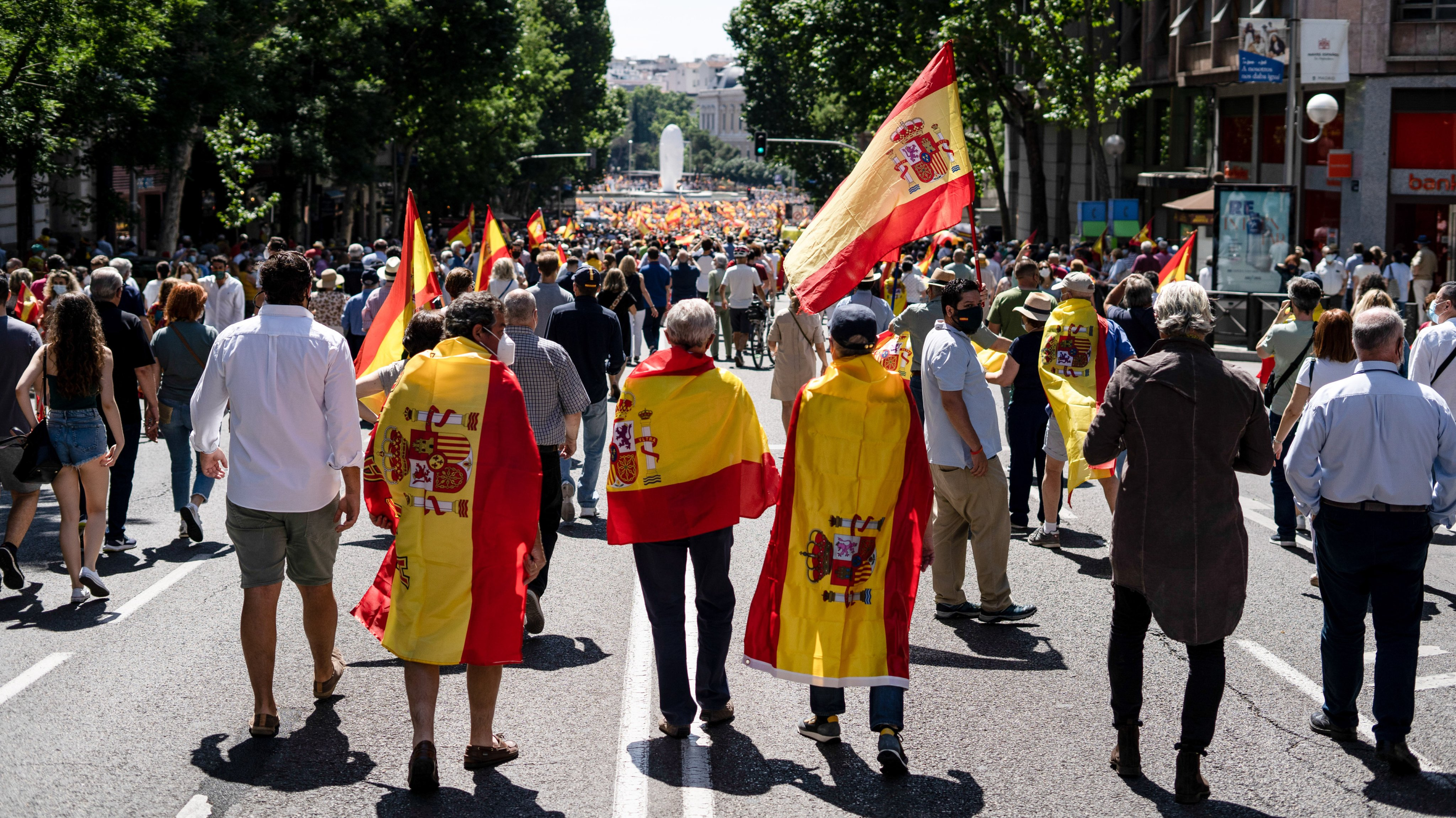 Protesters march on Genova Street, ahead is Colon square