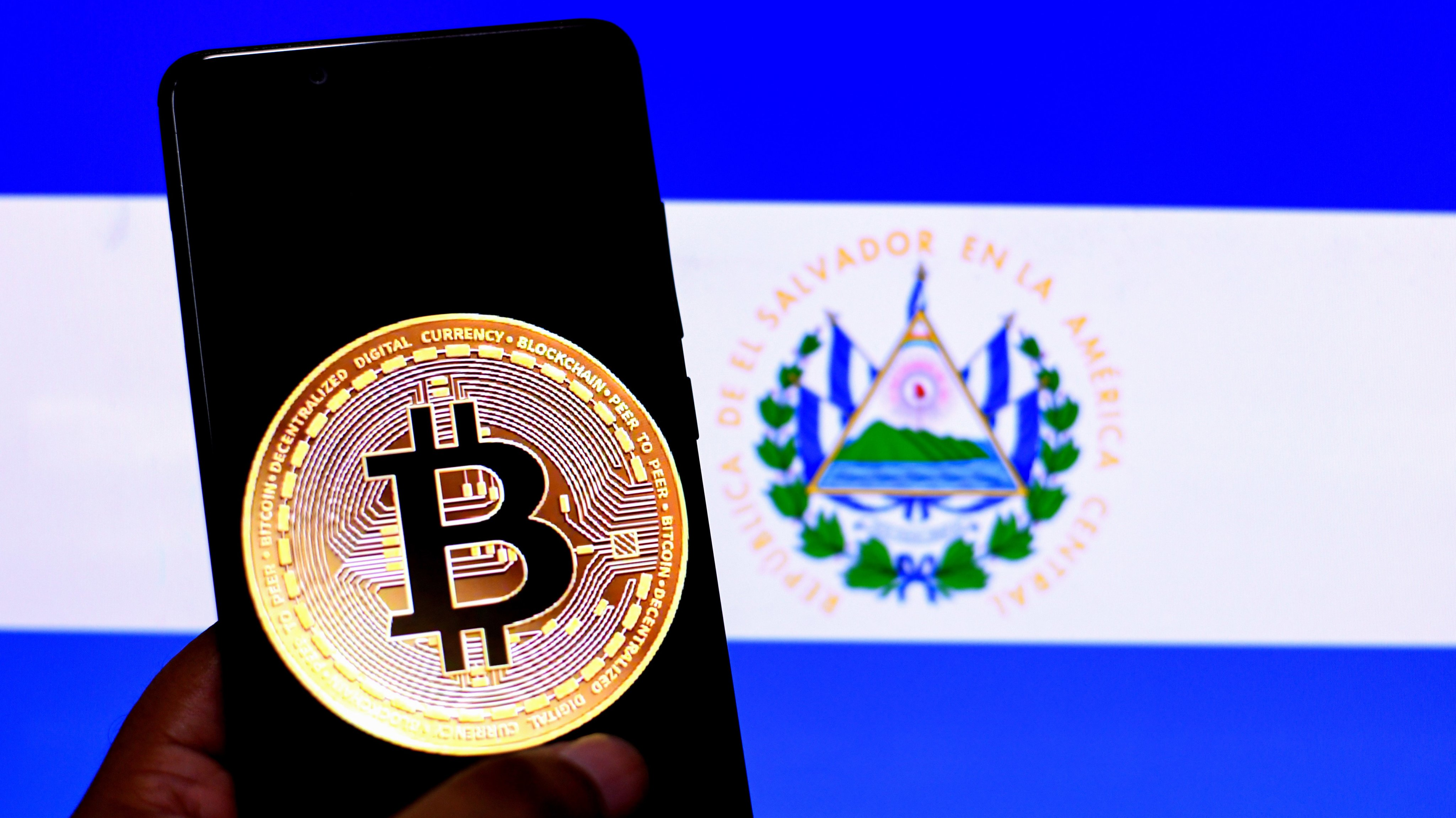 In this Photo illustration a Bitcoin logo seen displayed on