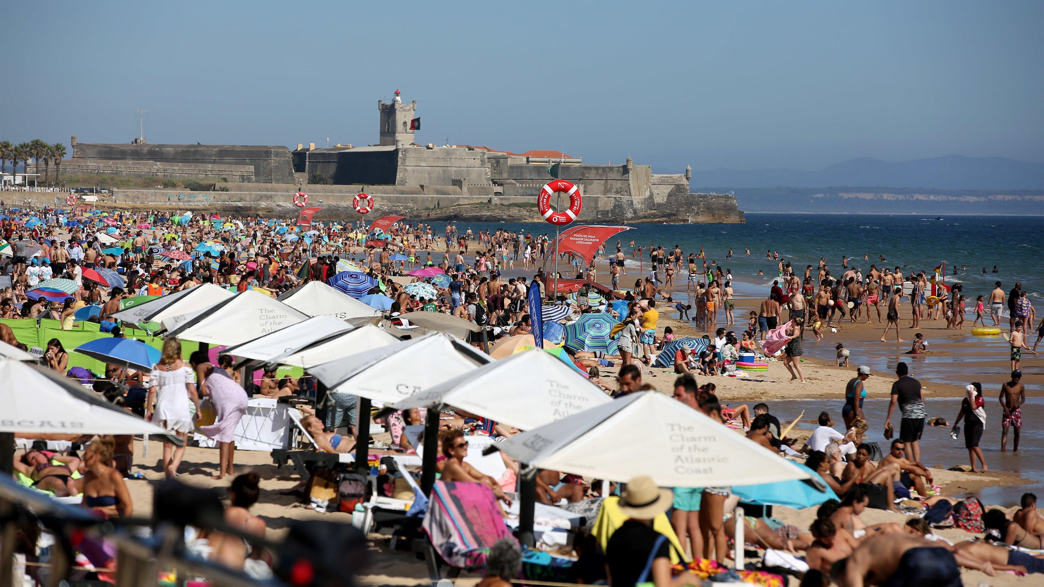Beachgoers crowd beaches near Lisbon amid COVID-19 pandemic