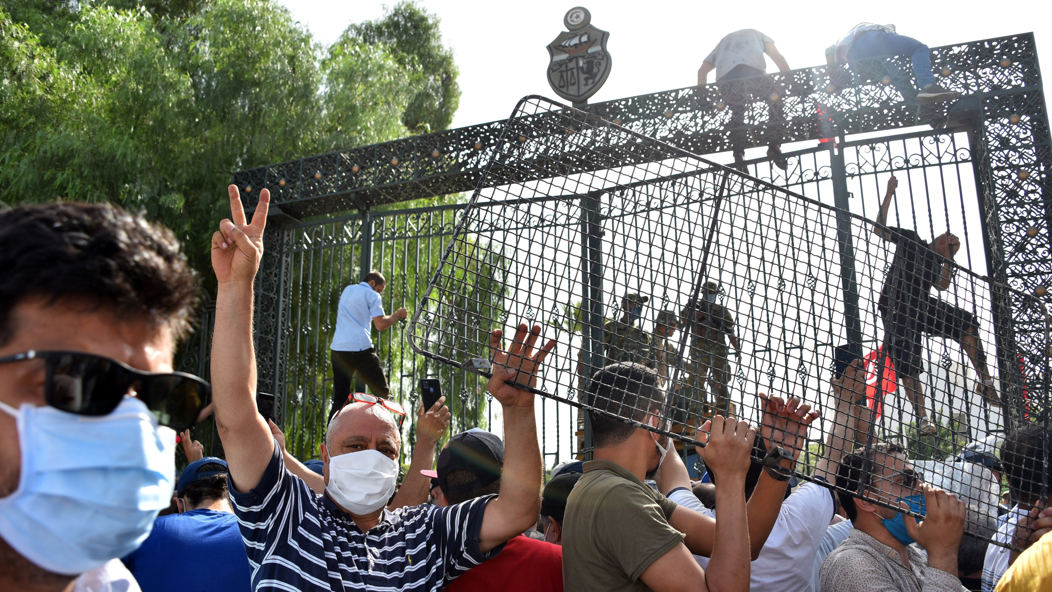 Supporters and opponents of coup gather in front of