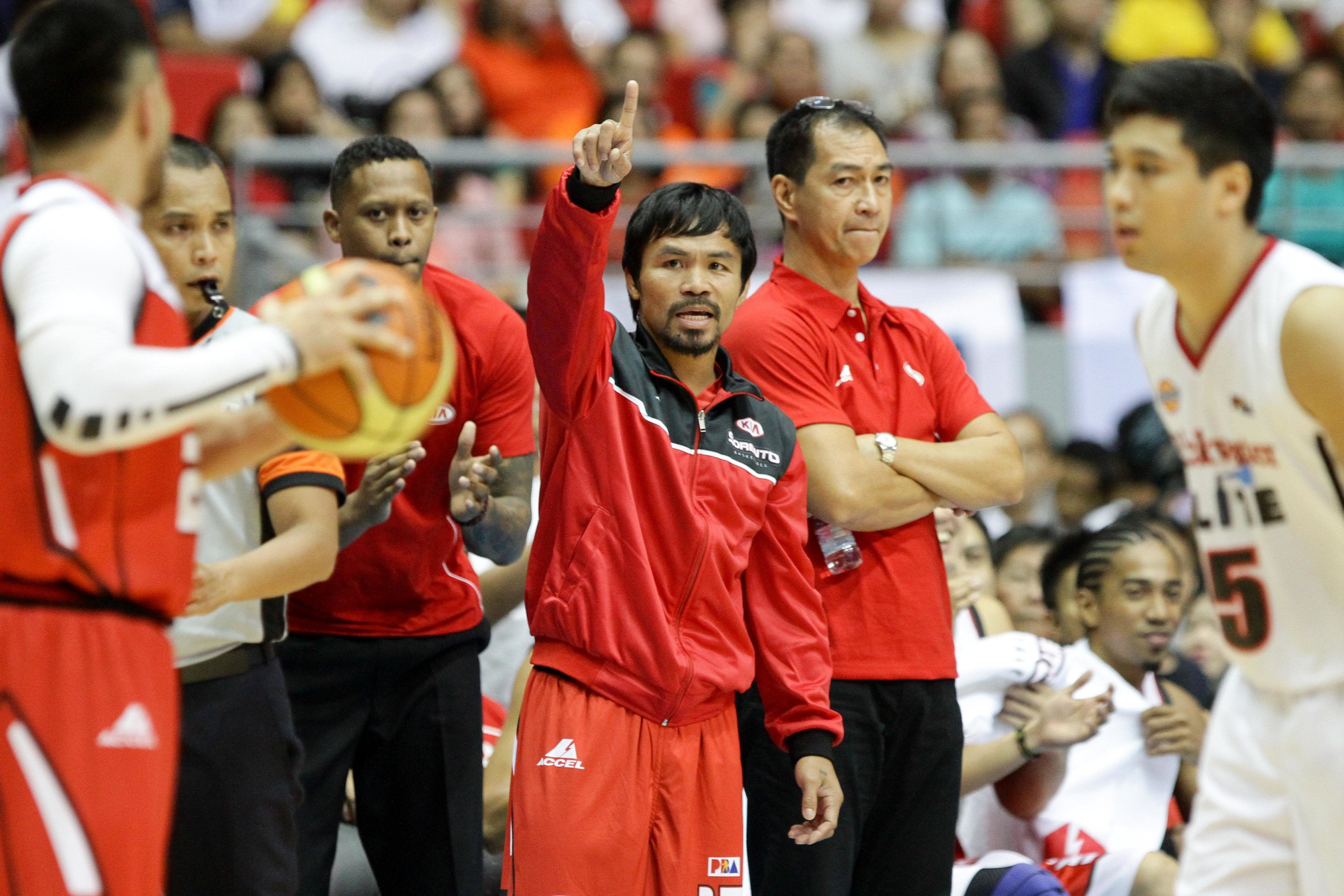 Manny Pacquiao head coach of Kia signals to his players in