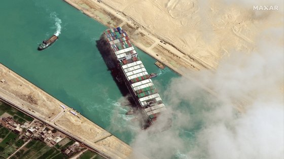 epa09105221 A handout satellite image made available by MAXAR Technologies shows , the Ever Given container ship after it has been moved away from the eastern bank of the canal and tugboats trying to reposition the ship, in the Suez Canal, Egypt, 29 March 2021. The head of the Suez Canal Authority announced on 29 March that the large container ship, which ran aground in the Suez Canal on 23 March, is now free floating after responding to the pulling maneuvers.  EPA/MAXAR TECHNOLOGIES HANDOUT --MANDATORY CREDIT: SATELLITE IMAGE 2021 MAXAR TECHNOLOGIES -- the watermark may not be removed/cropped -- HANDOUT EDITORIAL USE ONLY/NO SALES
