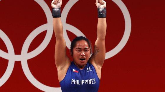 A filipina ficou à frente da chinesa Qiuyun Liao e da cazaque Zulfiya Chinshanlo, tornando-se a segunda atleta do país a conquistar mais do que uma medalha