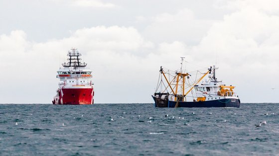 epa08815546 The Fisheries Patrol ship (L) seen next to Belgian fishing trawler Alles Wisselt (R) in the English Channel, off the south coast of Newhaven, East Sussex, Britain, 10 November 2020 (issued 12 November 2020). Skipper of the wooden-hulled vessel About Time Neil Witney, has been fishing in the English Channel since the mid-1980s and has watched the local industry shrink over the decades. Like many in the trade, he sees Brexit as an opportunity to revive the sector. 'Hopefully at the end of the year we can get some sort of deal, get our waters back, get control of our quota and then hopefully rebuild our industry and the rest of the maritime industry that goes with it,' he said. Fishing has become a major sticking point in the Brexit negotiations. An agreement on the issue is a prerequisite for a future trade deal between the UK and the European Union which, in theory, should be in place by end of the year. Under the current common fisheries policy, EU vessels have access to fishing grounds in the Exclusive Economic Zones of other member states, although quotas on hauls are negotiated every year. Once outside the EU, the UK will have full control over its EEZ, which stretches 200 nautical miles into the North Atlantic. But while Brussels and London pore over the details of a future deal, Witney cracks on with his job. Fishing from small trawlers is extremely weather dependent and he estimates that he is able to head out on between 150 to 180 days per year. Each time, he aims to make two catches, which means his shift can last up to 14 hours. On a typical day, he expects to catch around 30 different species of fish which, subject to quotas and marketability, will all be kept. 'We used to be able to fish for sprats, herrings, mackerel here but this year we've seen a lot of tuna, but we've got no quota for tuna or horse mackerel and we've lost all the market for things like sprats so at the moment it's almost uneconomical to go fishing. Hopefully things will c