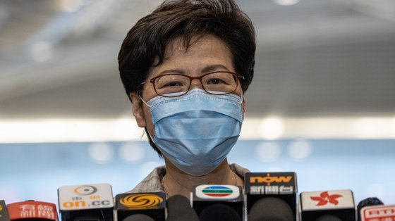 epa09475828 Hong Kong Chief Executive Carrie Lam meets reporters after visiting the polling station at the Convention Centre during the 2021 Election Committee Subsector Ordinary Elections in Hong Kong, China, 19 September 2021. The Election Committee is an electoral college with the function of selecting the Chief Executive and, beginning in 2021, to elect 40 members the 90 members of the Legislative Council. In 2021 China's National People's Congress passed a law that changed the electoral system in the former British colony, augmenting the size of the Election Committee to 1,500 members to include 'patriotic groups' and members of the Chinese People's Political Consultative Conference among others. Only 364 places on the 1,500-member Election Committee are up for grabs with most seats predetermined as uncontested or appointed and only 4,889 voters representing different professions and trades casting their ballots.  EPA/JEROME FAVRE
