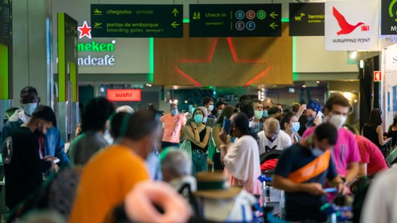 Passengers wait hours in long lines for their flight due to a strike of the handling company, Groundforce, which is causing major disruption in the Lisbon Airport, causing the cancelation of dozens of flights, in Lisbon, Portugal, 17 July 2021. Groundforce workers are protesting against colective dismissal of workers and low salaries. JOSE SENA GOULAO/LUSA