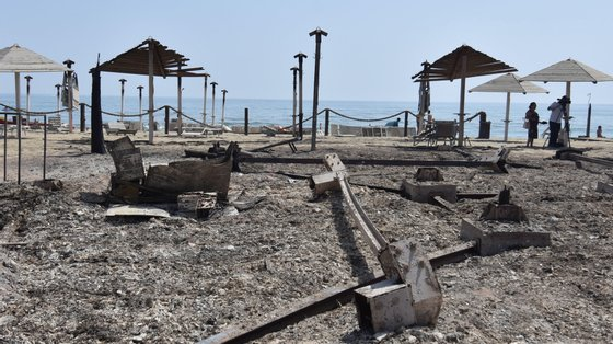 epa09382506 A view of a bathing establishment destroyed by a fire near Catania, Sicily Island, southern Italy, 31 July 2021. A largest number of forest fires are burning in Sicily. Fire brigade teams on the ground are currently engaged in Catania on various vegetation fires that are affecting the area.  EPA/ORIETTA SCARDINO